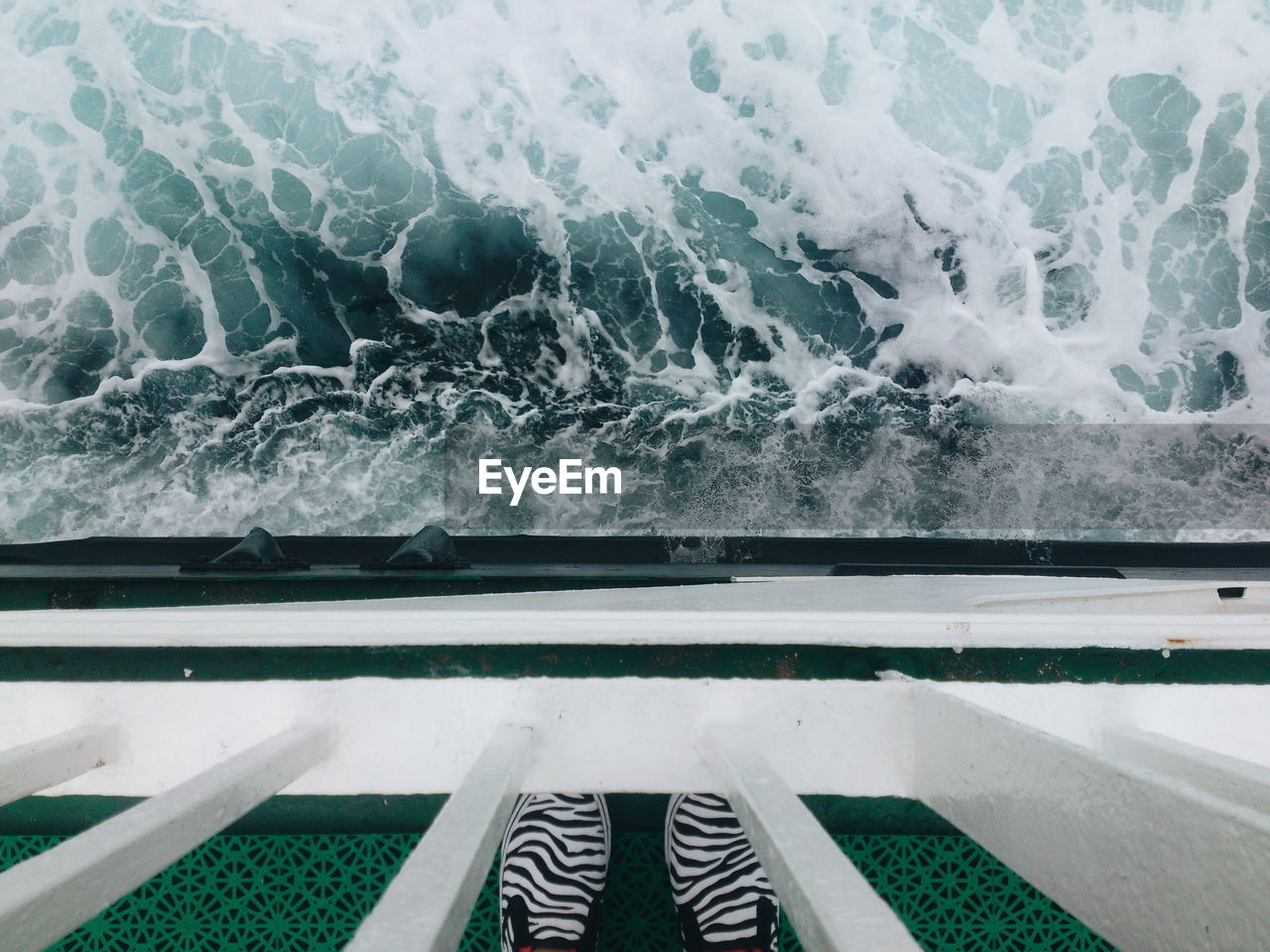 Low Section Of Person In Ferry Sailing On Sea