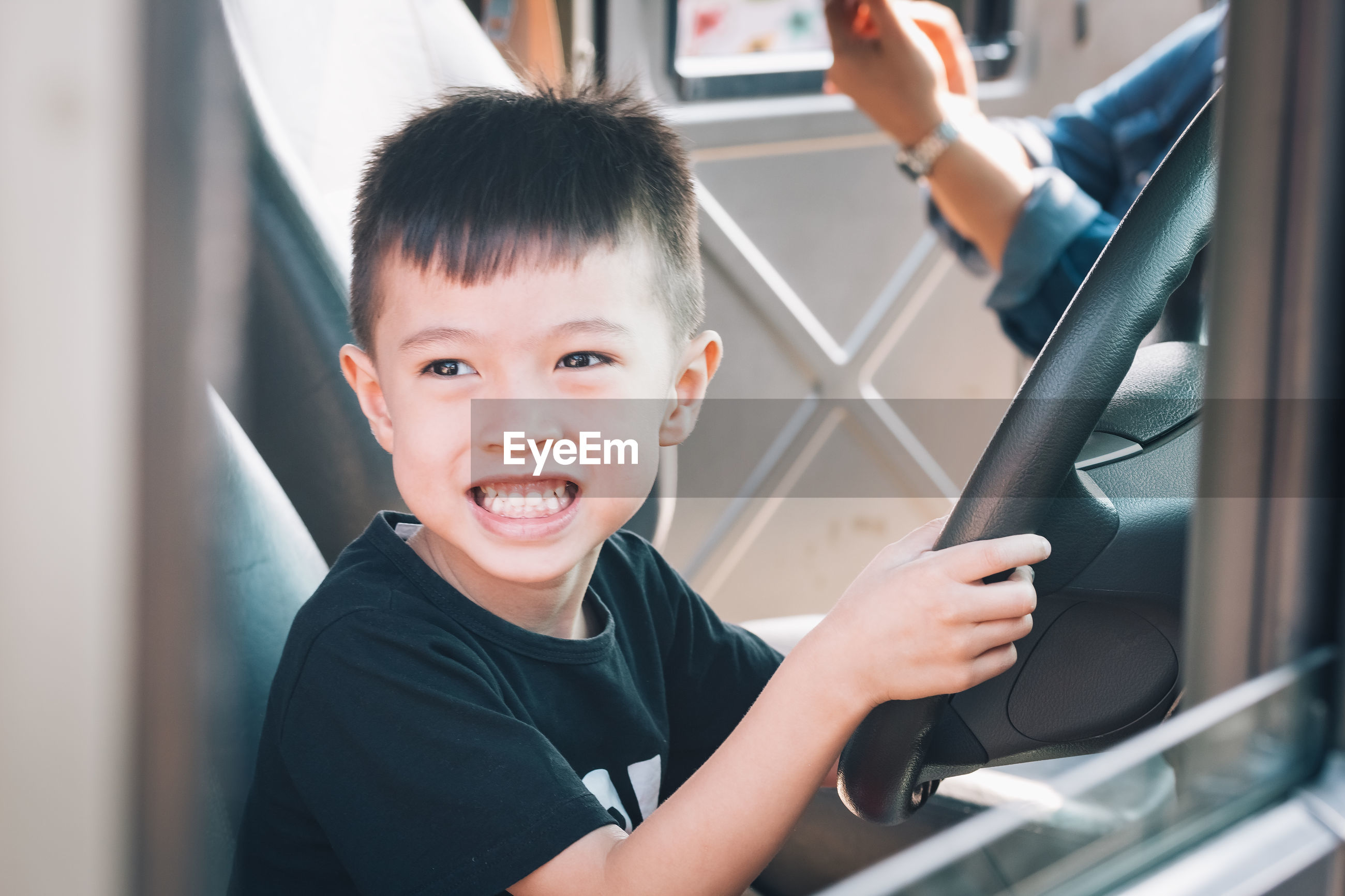 Portrait of boy in vehicle