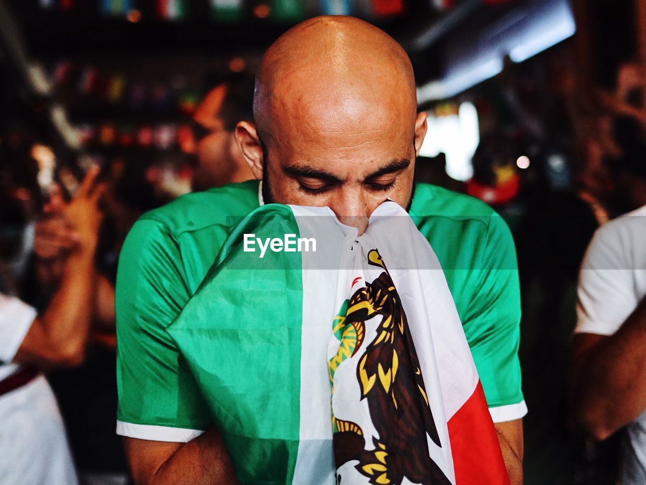Bald Man With Eyes Closed Holding Flag