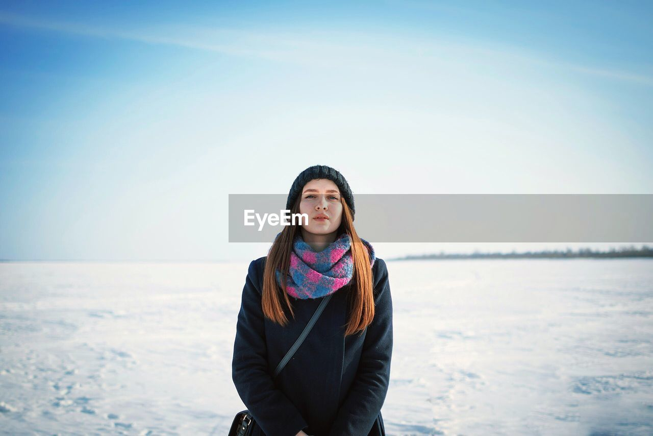 Portrait of young woman standing outdoors during winter
