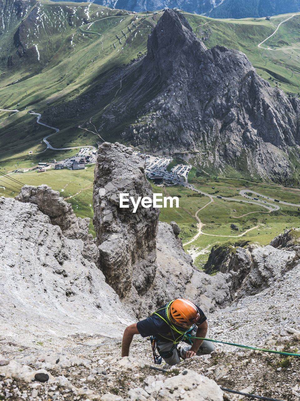 mountain, rock, rock - object, solid, climbing, leisure activity, adventure, one person, nature, day, lifestyles, real people, rock formation, men, activity, sport, helmet, mountain range, scenics - nature, beauty in nature, formation, outdoors