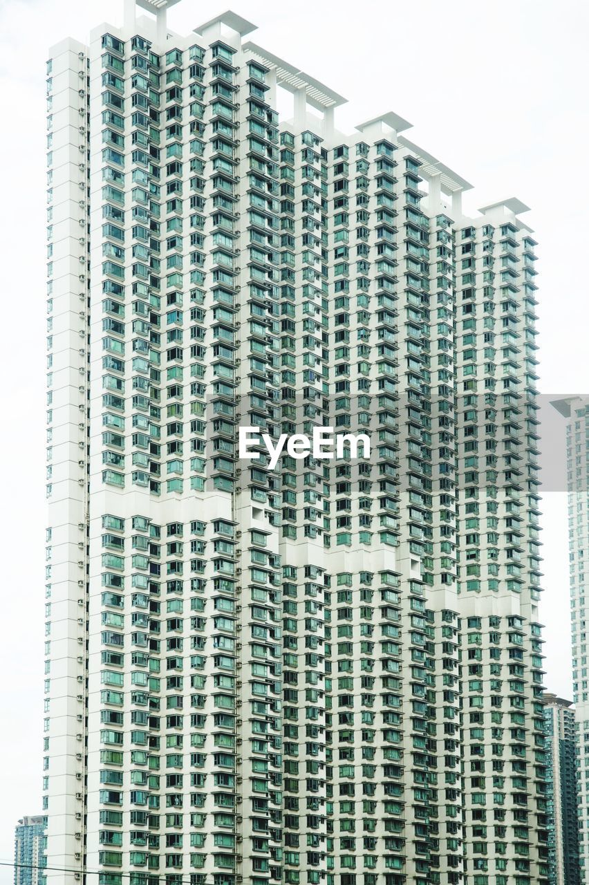 building exterior, built structure, architecture, building, city, office building exterior, tall - high, office, skyscraper, tower, no people, modern, low angle view, day, sky, business, nature, outdoors, residential district, development, apartment, financial district