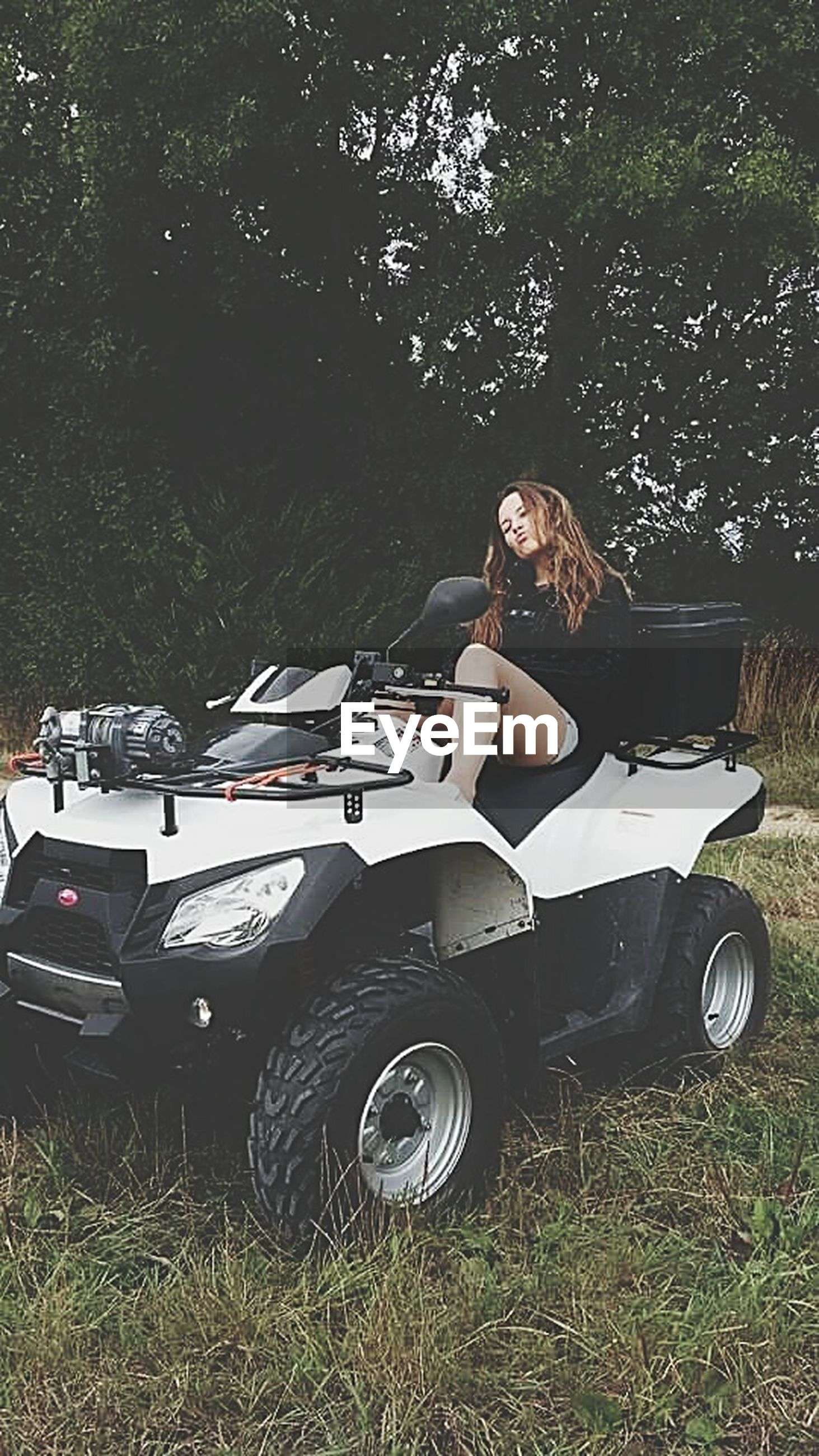 land vehicle, transportation, mode of transport, grass, car, field, stationary, grassy, parking, parked, bicycle, day, outdoors, high angle view, abandoned, sunlight, motorcycle, travel, absence, one person
