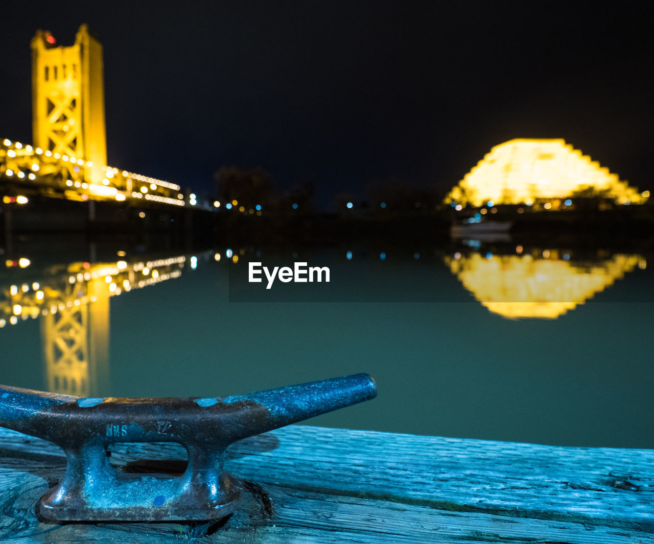 night, architecture, outdoors, water, no people, built structure, statue, illuminated, river, focus on foreground, close-up, history, building exterior, travel destinations, sculpture, sky, city, nature