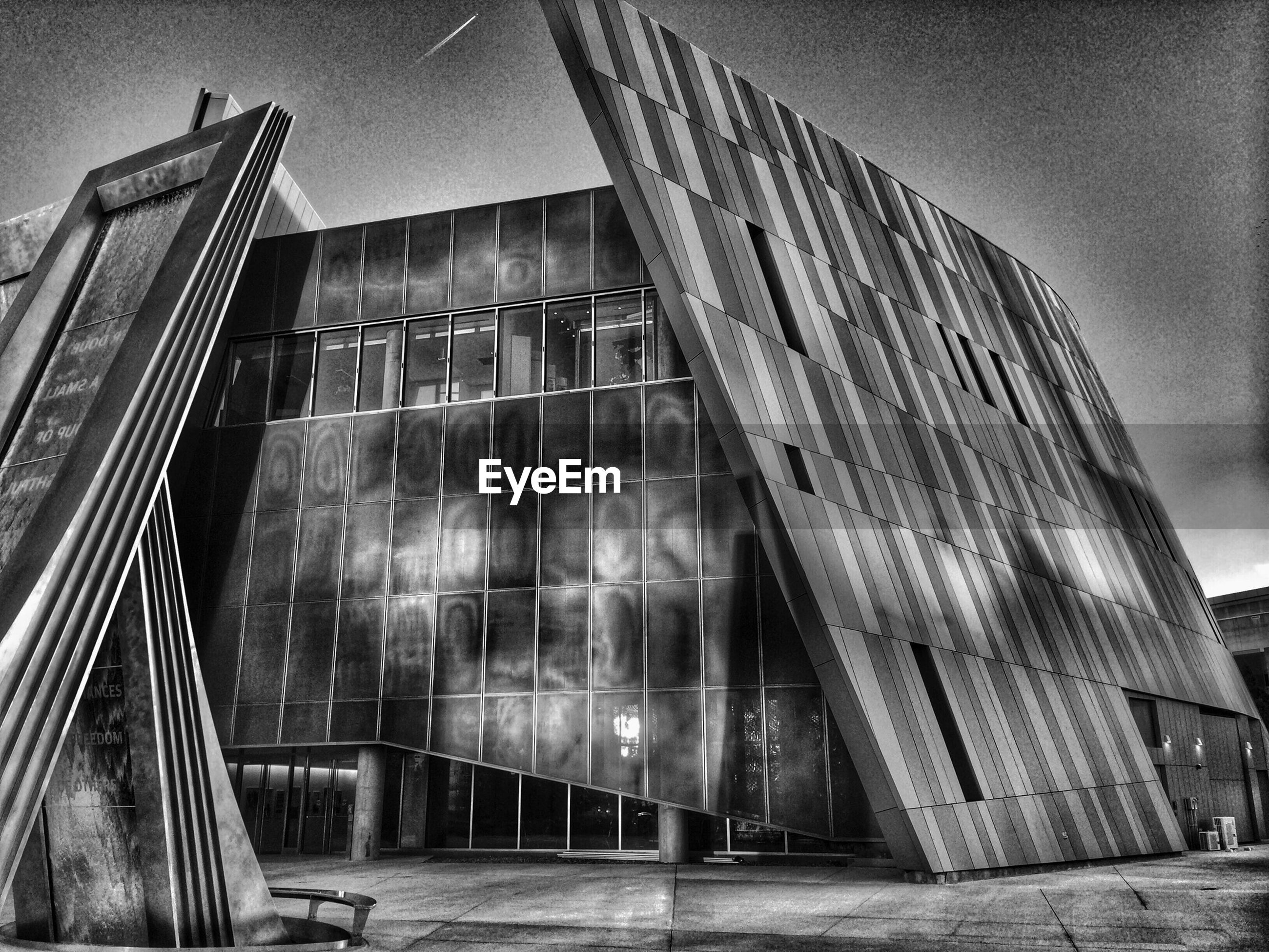 architecture, built structure, building exterior, low angle view, glass - material, window, building, reflection, modern, sky, city, office building, day, no people, outdoors, tall - high, sunlight, exterior, glass, residential building