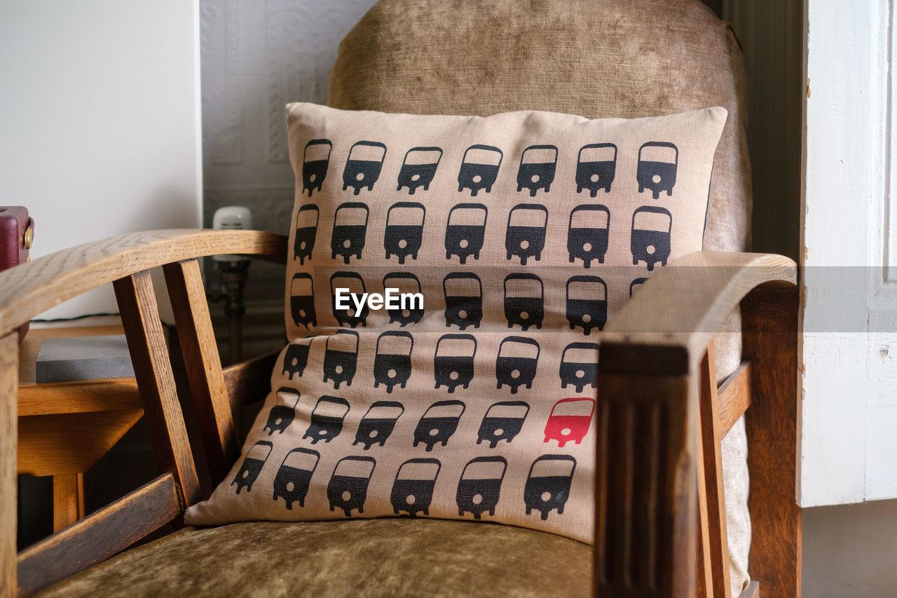 Cushion on chair at home