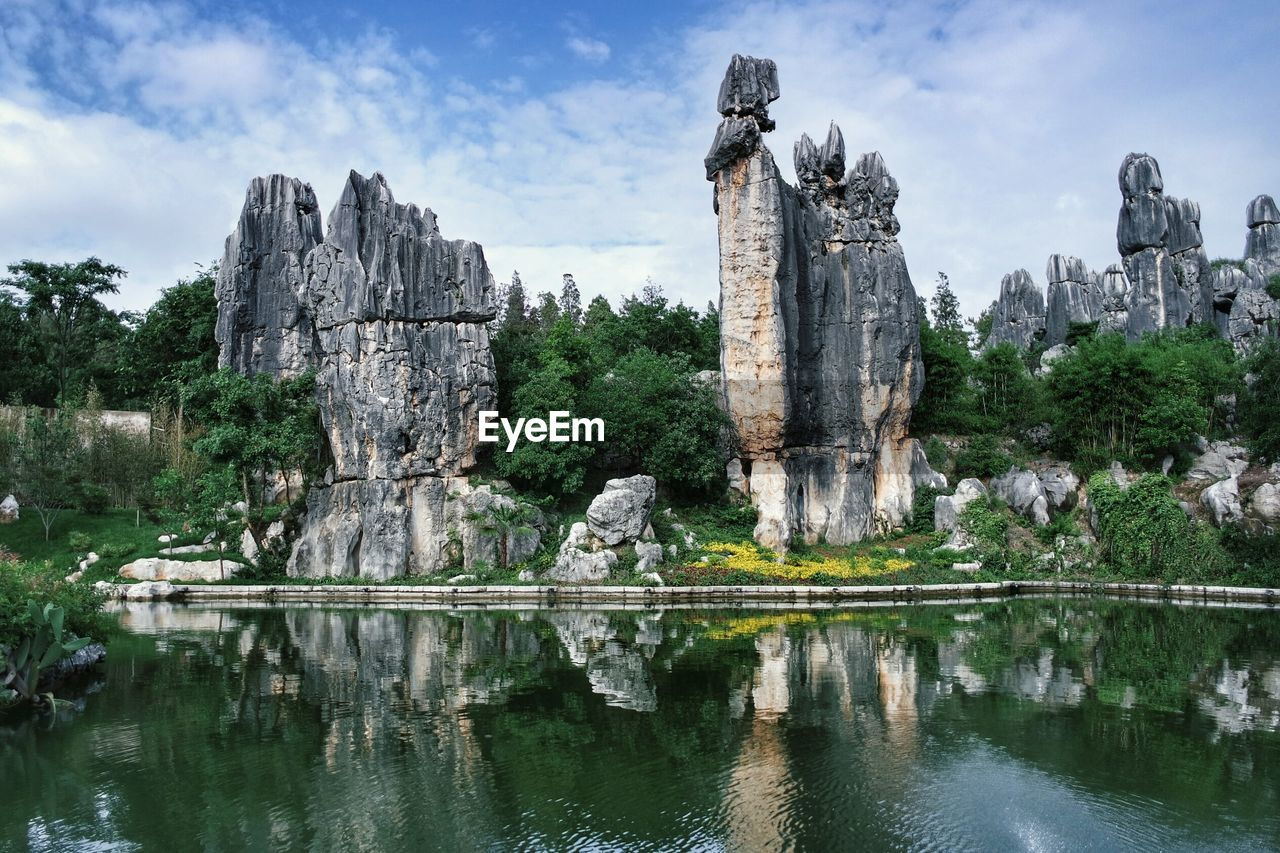 Scenic View Of Stone Forest Reflection In River