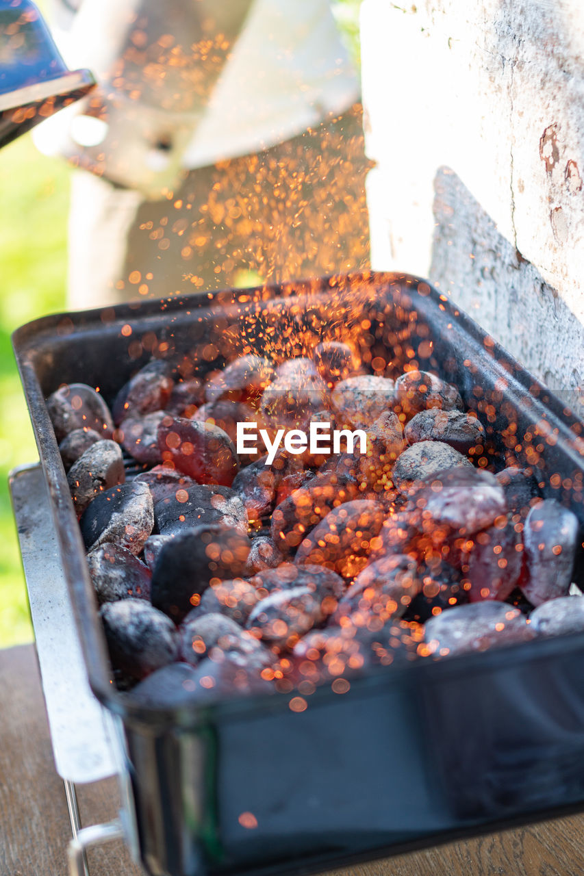 food, food and drink, heat - temperature, meat, preparation, barbecue, freshness, burning, barbecue grill, close-up, selective focus, day, preparing food, kitchen utensil, focus on foreground, fire, grilled, fire - natural phenomenon, no people, high angle view, outdoors, temptation, dinner