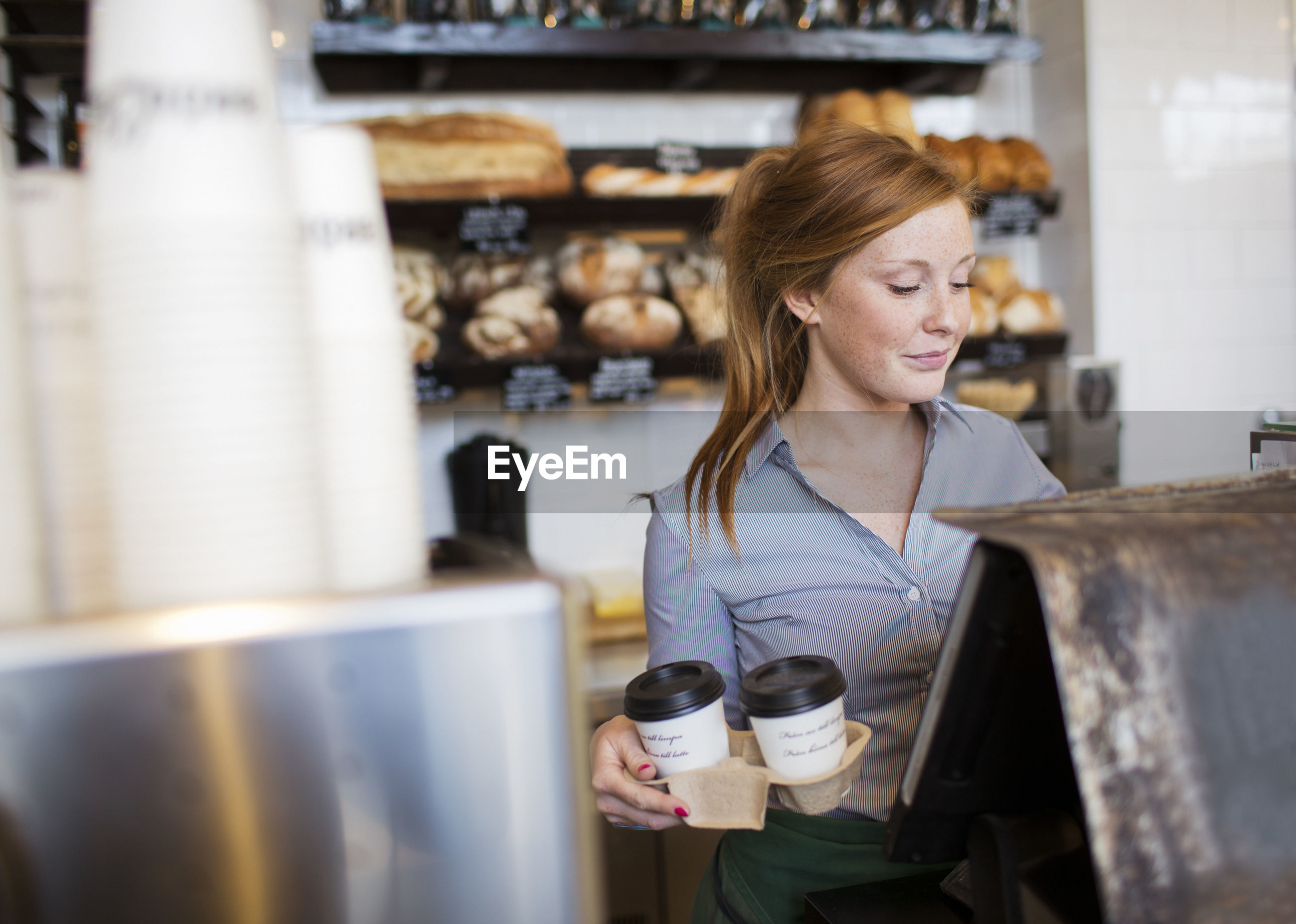 WOMAN WITH COFFEE BEANS IN STORE