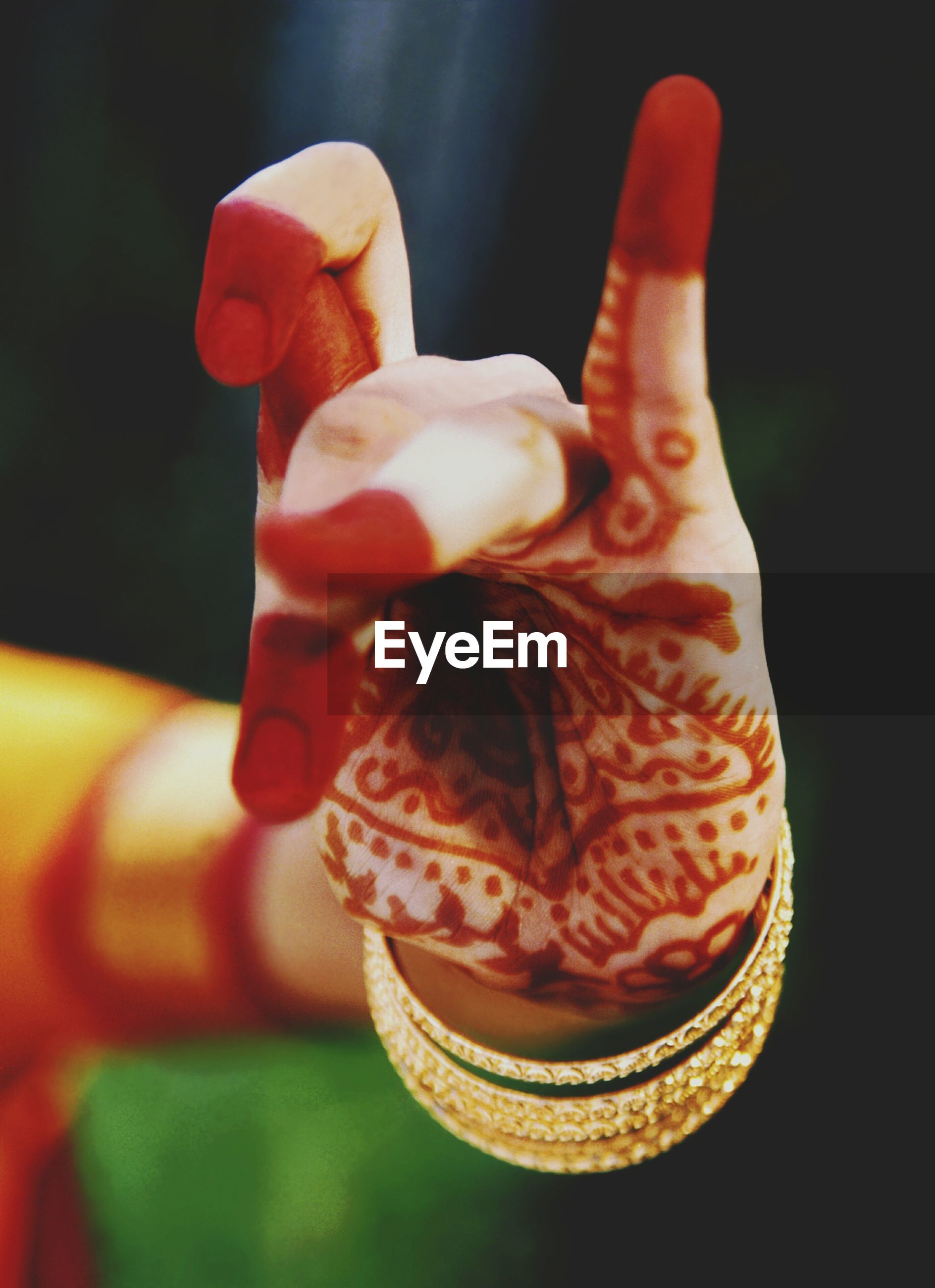 Close-up of woman hand with henna tattoo gesturing