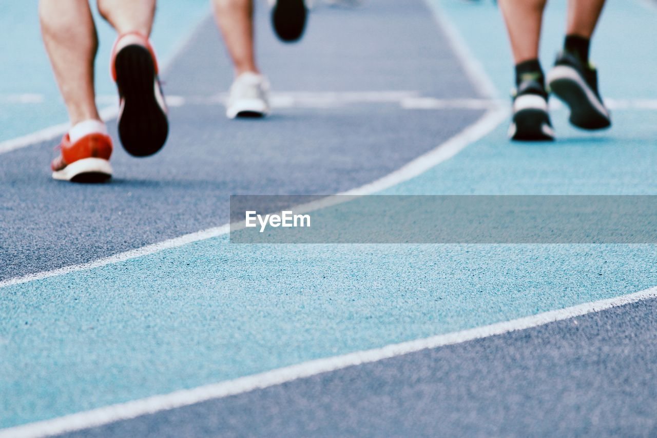 Low Section Of Athletes Running On Track