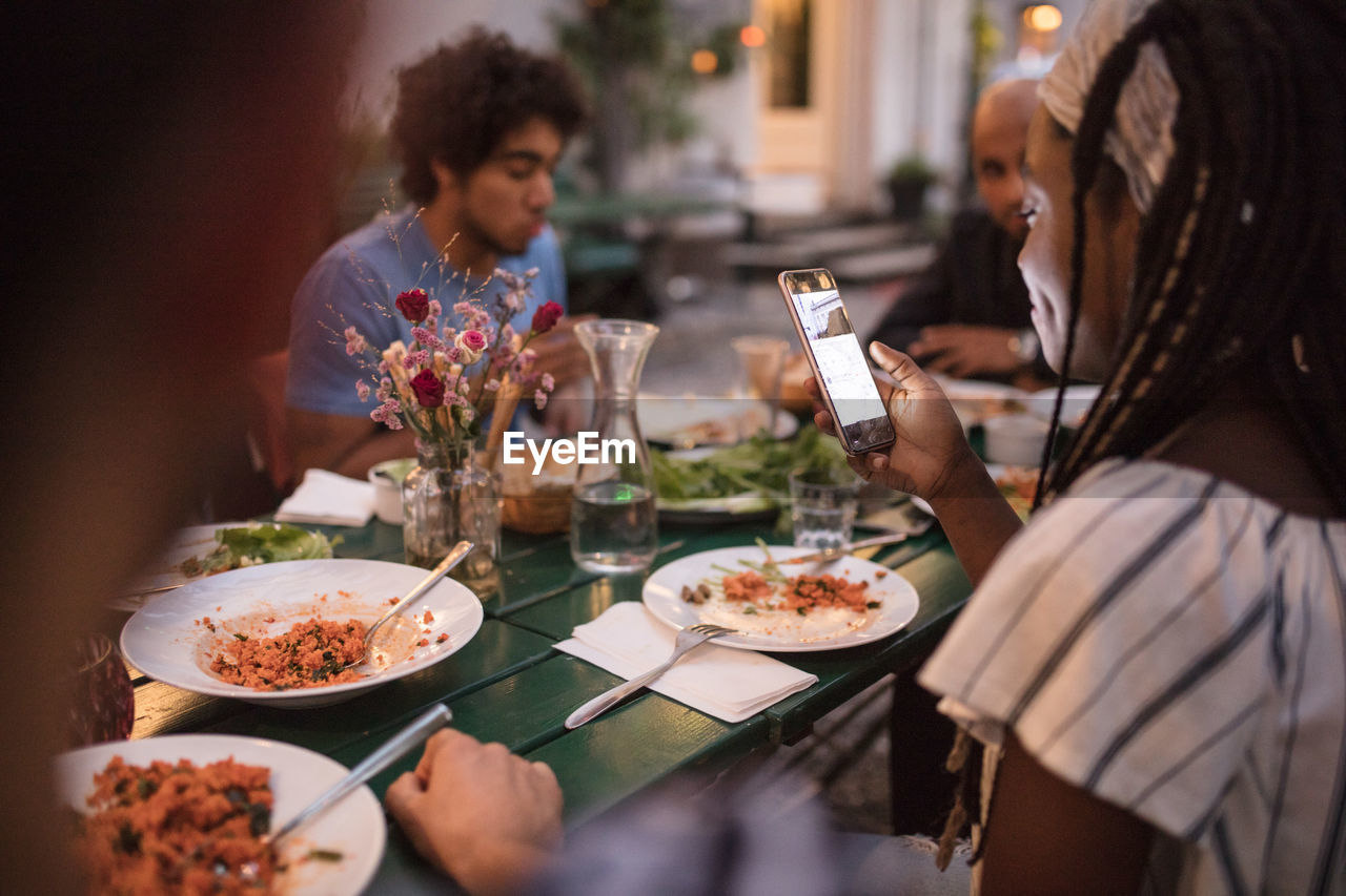 food and drink, table, real people, women, lifestyles, food, group of people, sitting, adult, togetherness, drink, plate, glass, friendship, meal, business, leisure activity, restaurant, people, dinner