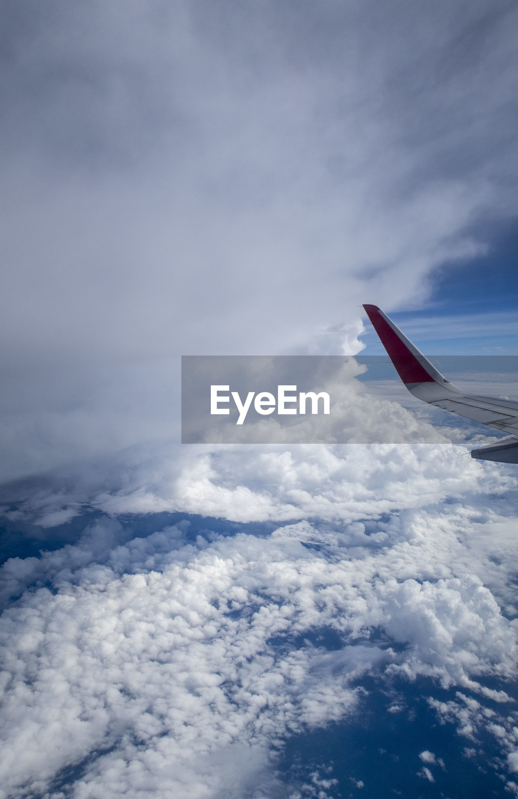 cloud - sky, airplane, sky, air vehicle, mode of transportation, transportation, flying, aircraft wing, beauty in nature, no people, nature, scenics - nature, day, mid-air, cloudscape, travel, motion, white color, on the move, outdoors, meteorology