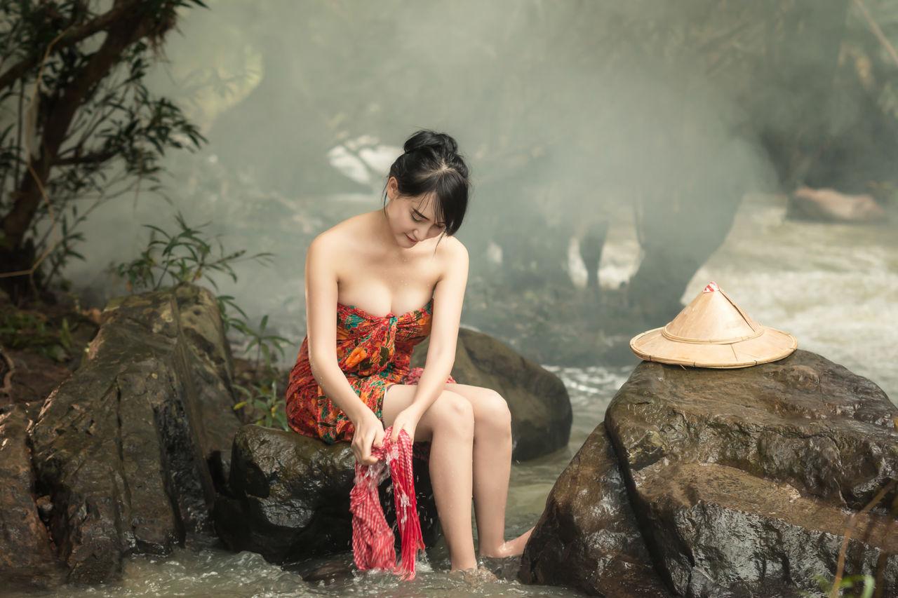 Woman Washing Cloth In Lake