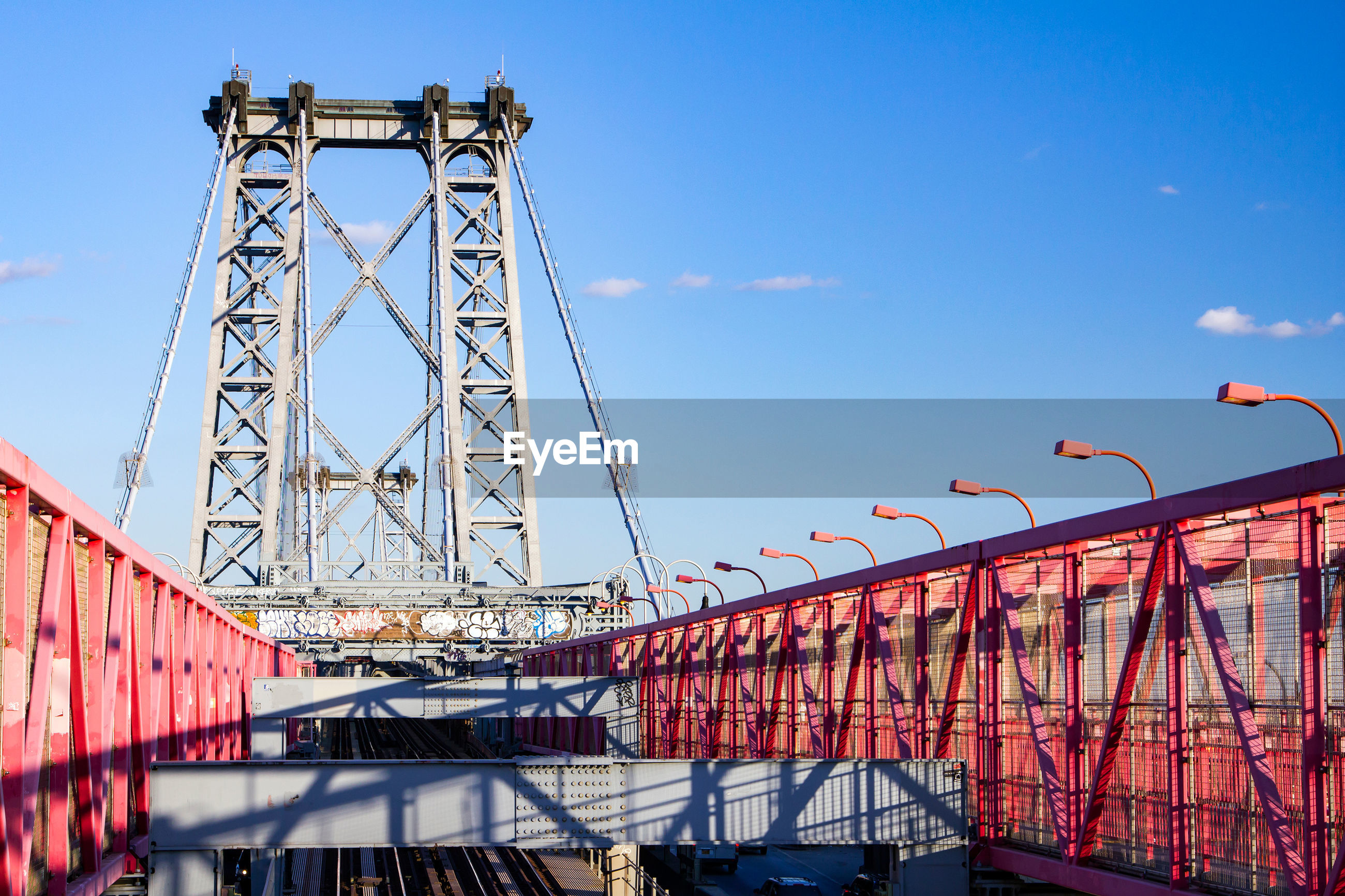 LOW ANGLE VIEW OF BRIDGE IN BLUE SKY