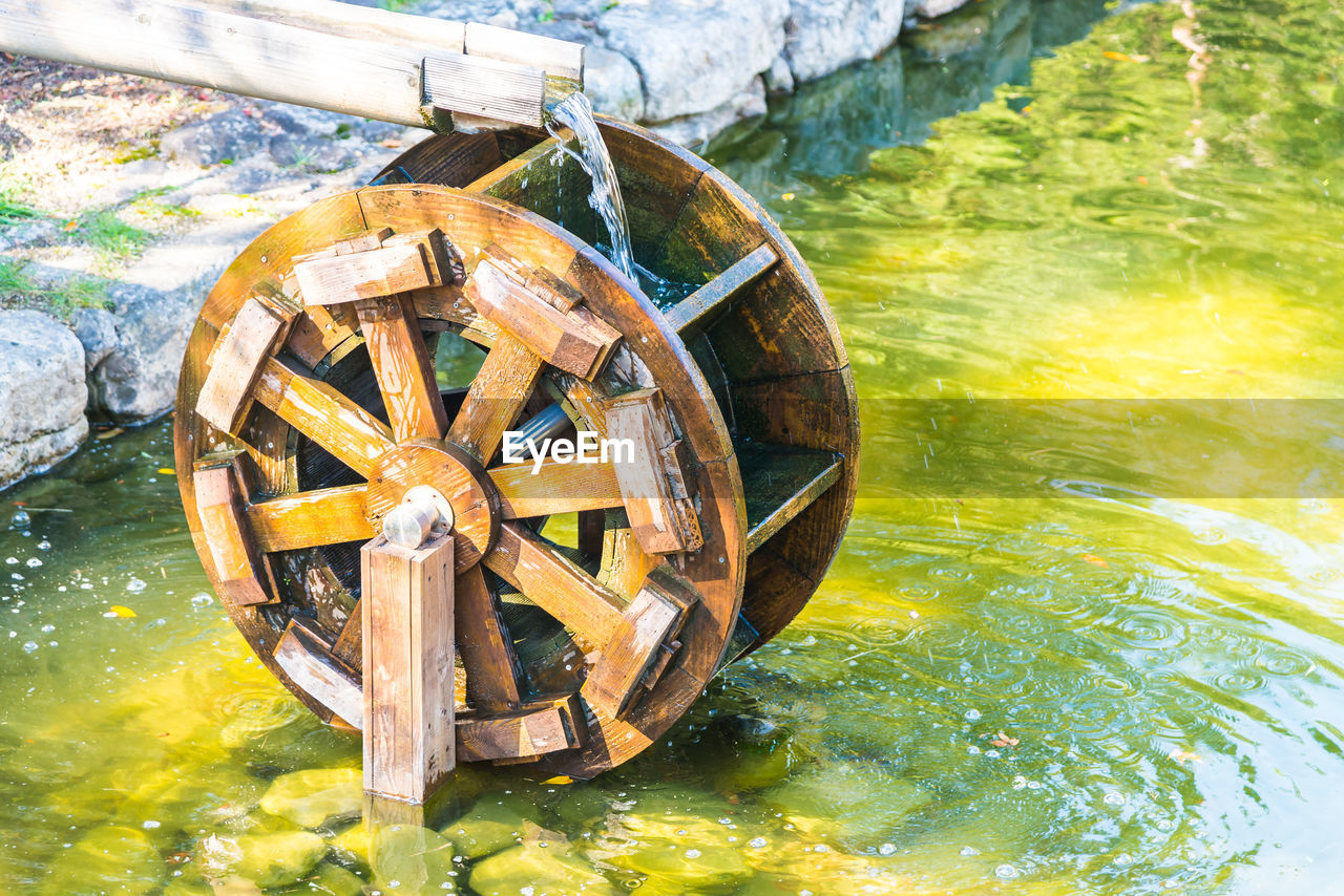 water, water wheel, nature, transportation, wood - material, wheel, watermill, no people, day, nautical vessel, outdoors, old, mode of transportation, sunlight, lake, retro styled, waterfront, wagon wheel