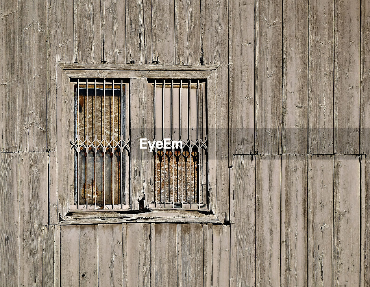 wood - material, wall - building feature, no people, built structure, metal, day, architecture, old, pattern, safety, hanging, security, protection, window, building exterior, close-up, outdoors, full frame, closed