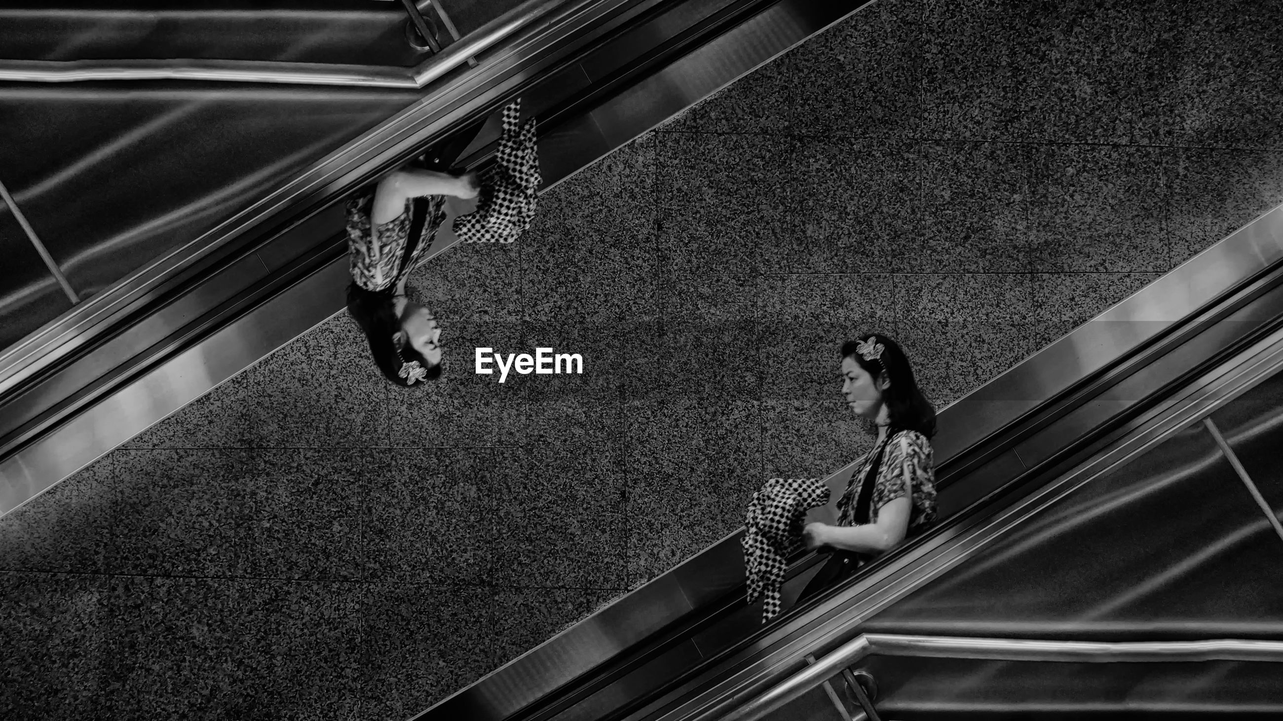 Multiple image of woman standing on escalator