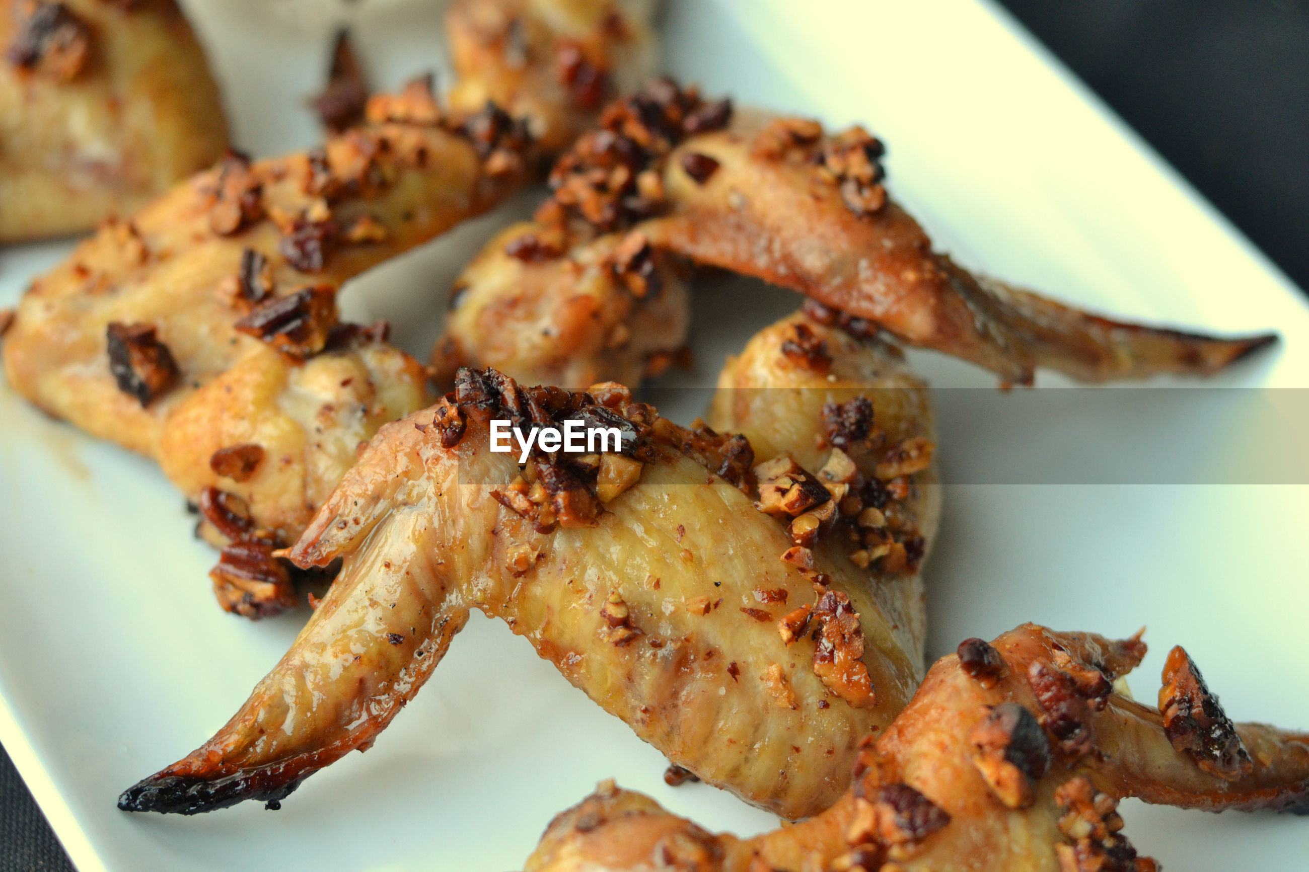 Close-up of chicken meat in plate on table