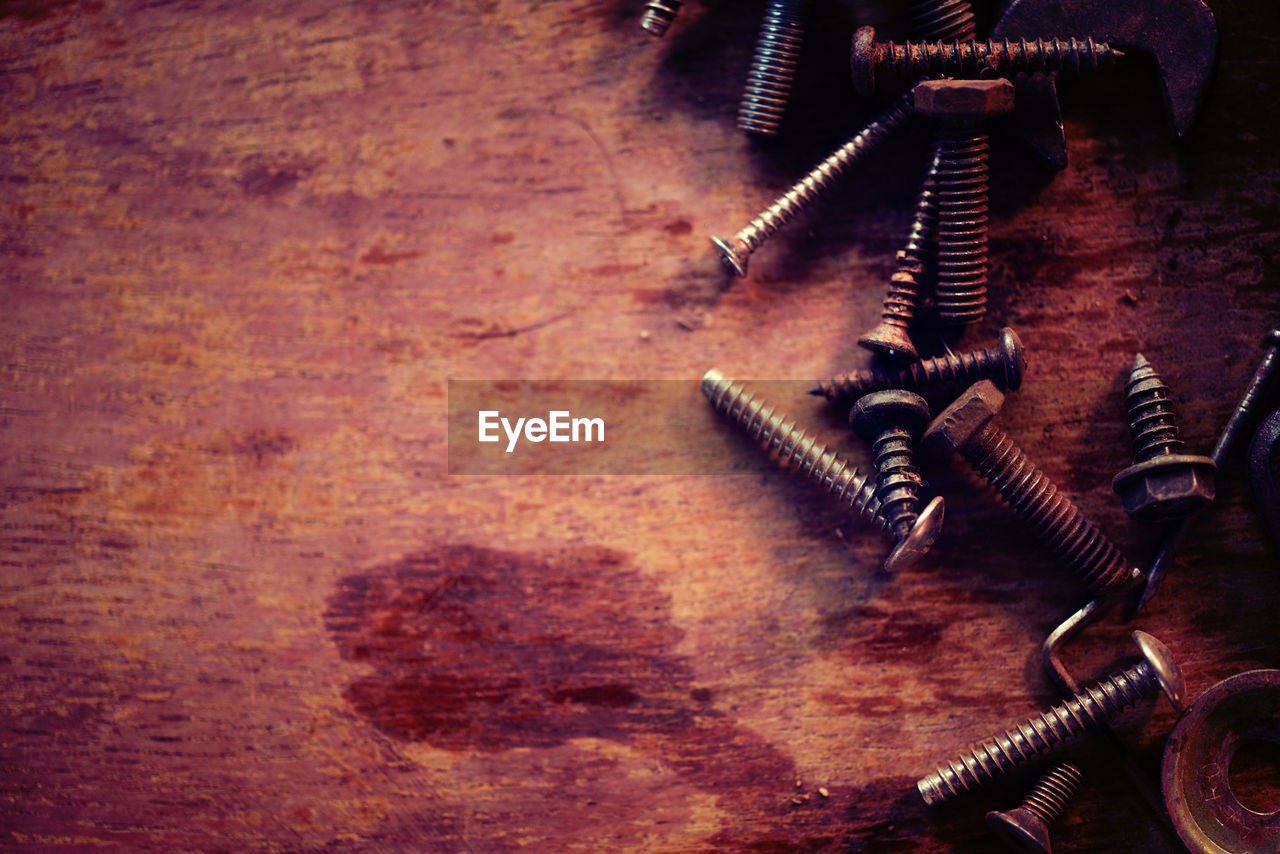 work tool, spiral, metal, equipment, table, indoors, nut - fastener, no people, industry, serrated, close-up, day