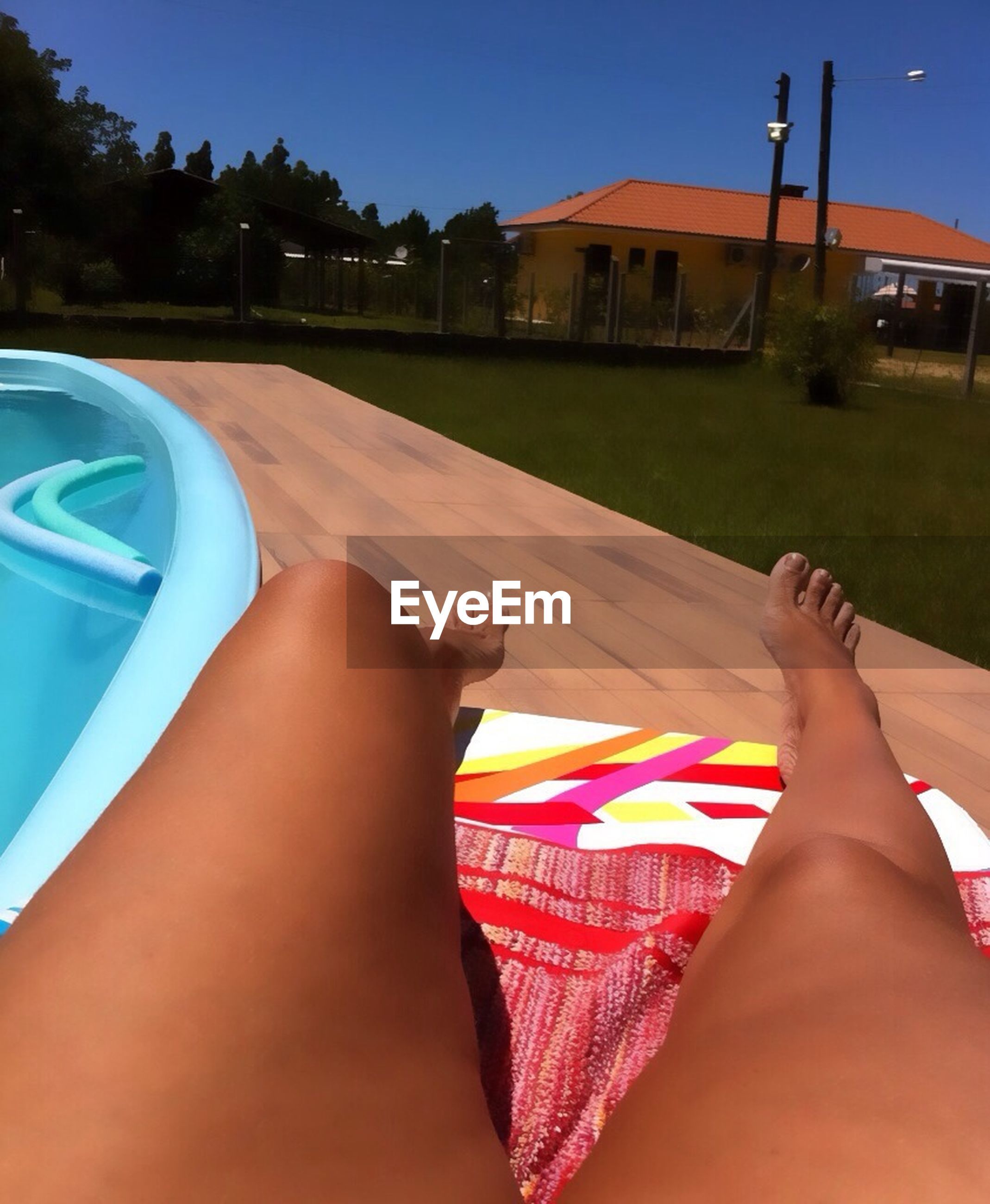 low section, person, barefoot, personal perspective, lifestyles, relaxation, leisure activity, human foot, sitting, part of, swimming pool, resting, relaxing, lying down, sunlight