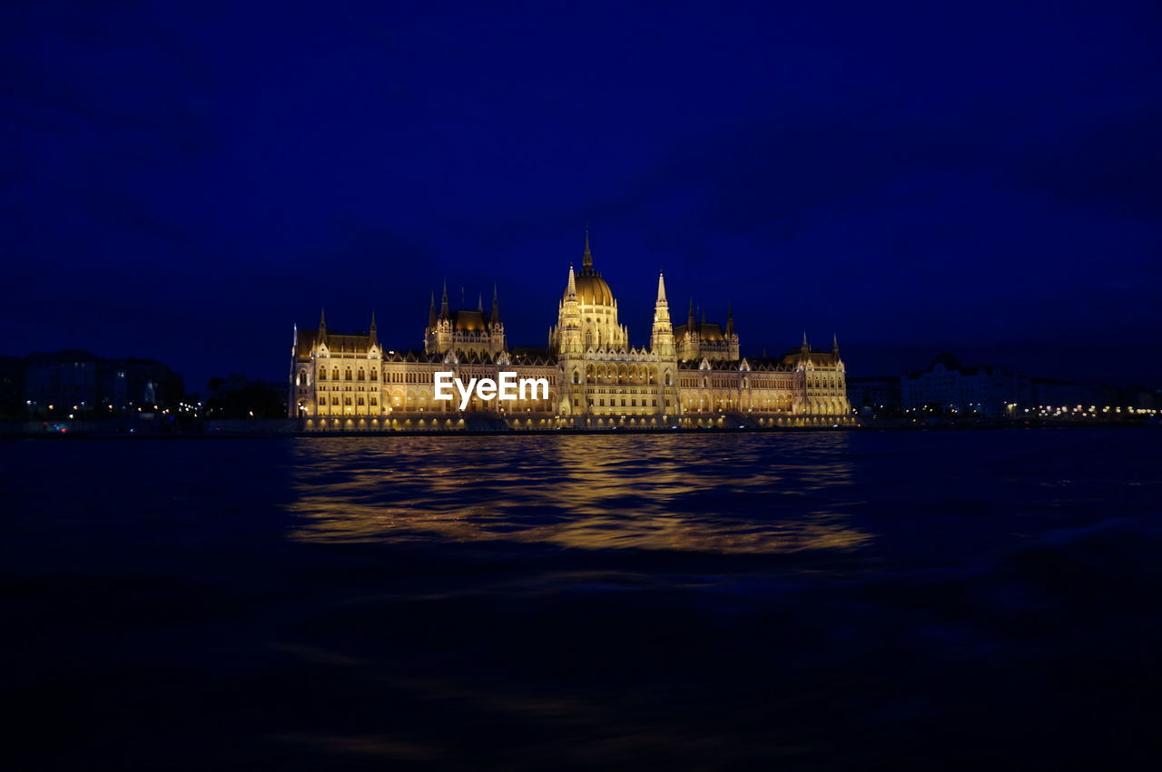 building exterior, built structure, illuminated, architecture, night, water, waterfront, travel destinations, sky, no people, government, dusk, blue, tourism, city, the past, nature