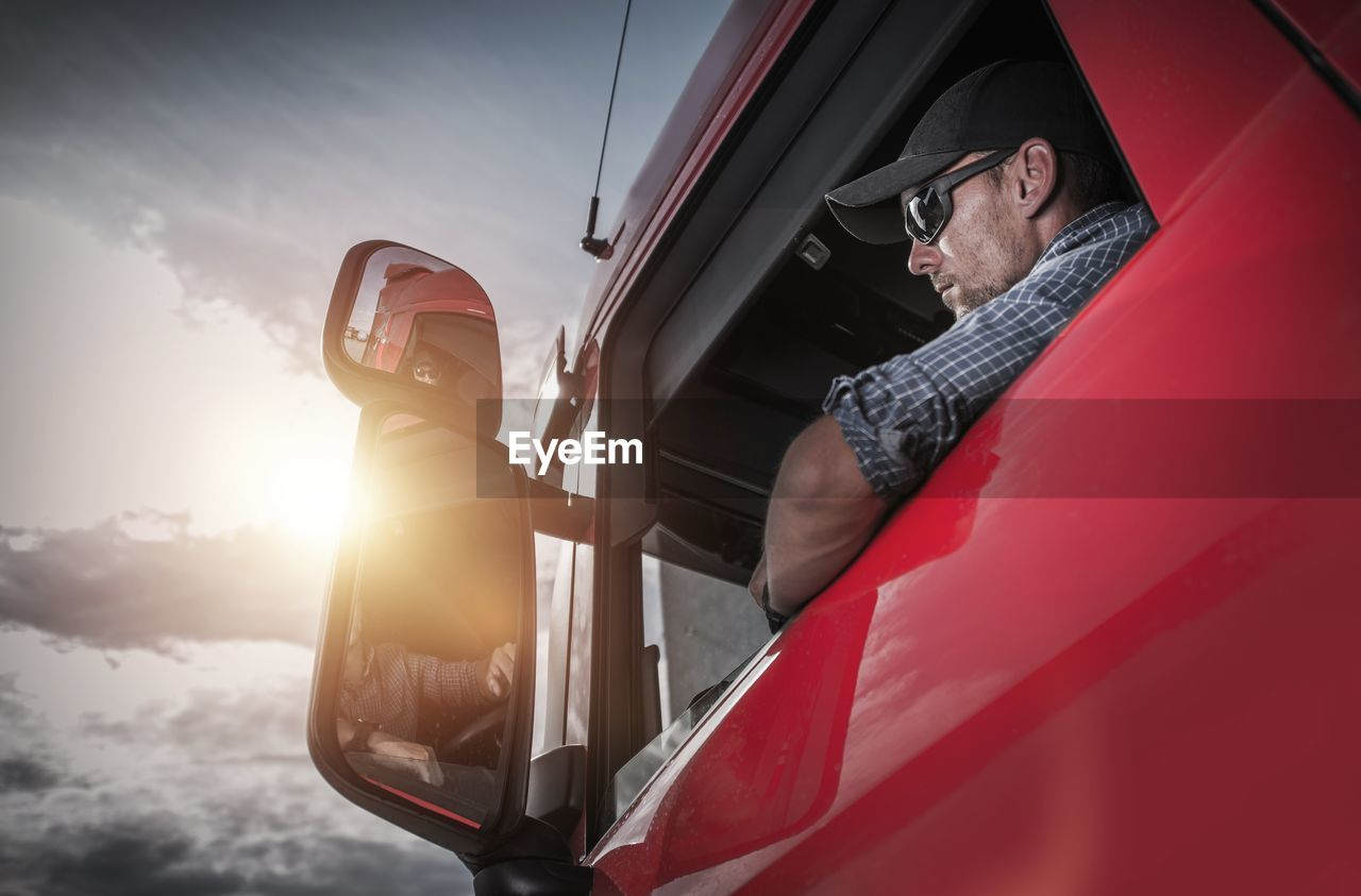 Low angle view of man in truck