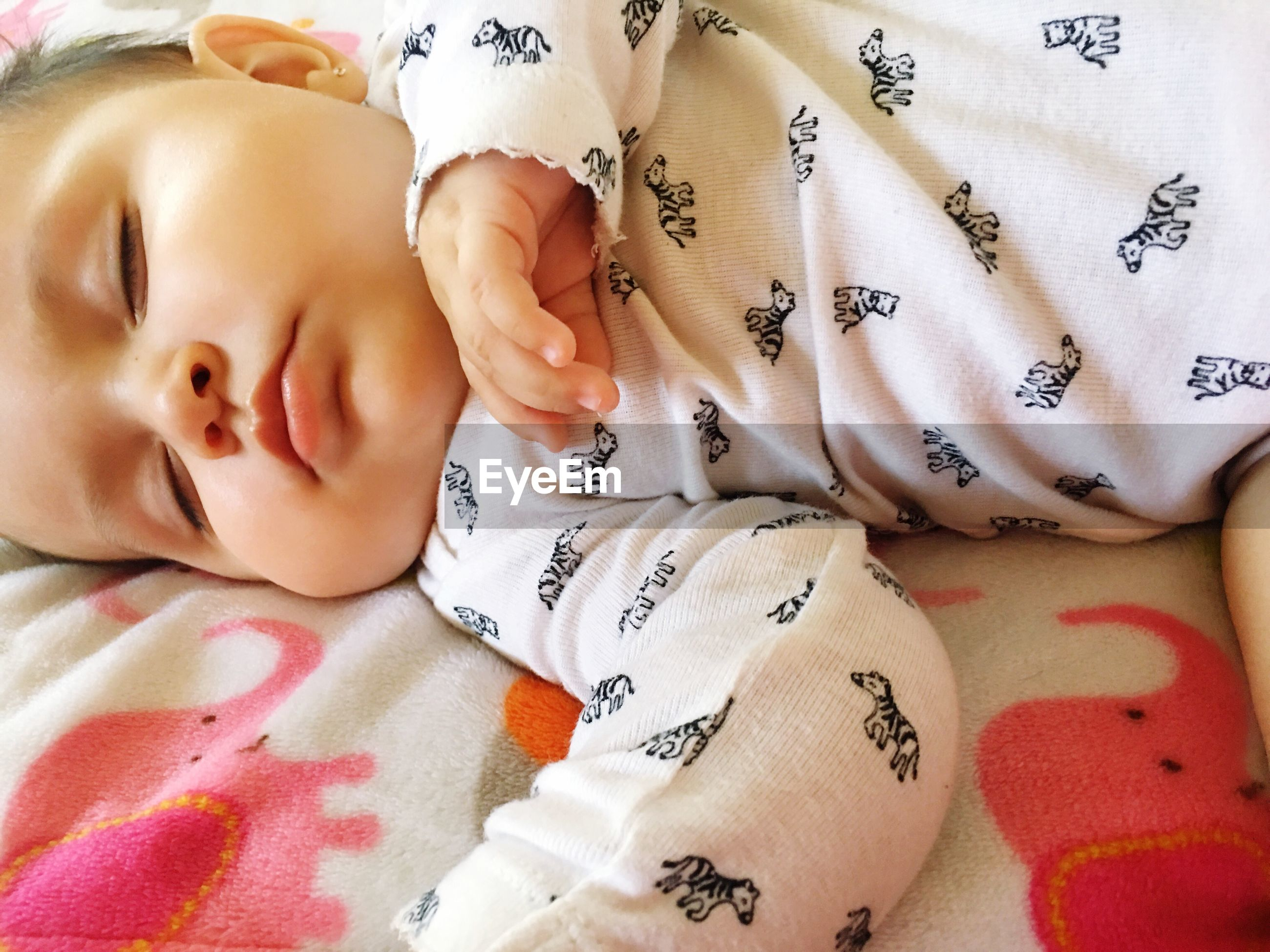 baby, bed, real people, lying down, sleeping, innocence, indoors, cute, babyhood, fragility, high angle view, lying on back, relaxation, one person, headshot, newborn, childhood, new life, close-up, bedroom, day, babies only, people