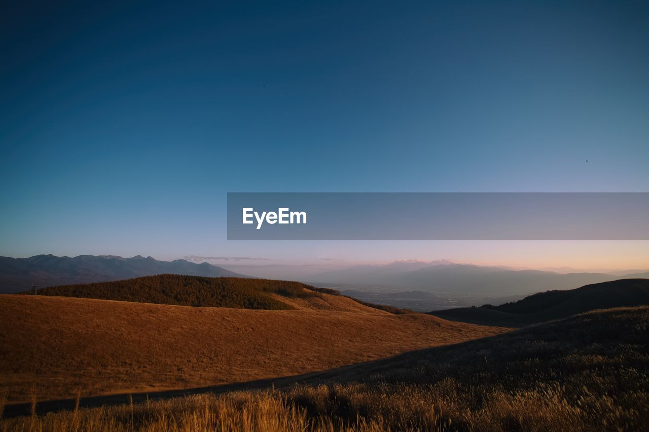 sky, mountain, scenics - nature, beauty in nature, tranquil scene, tranquility, environment, landscape, sunset, mountain range, copy space, non-urban scene, clear sky, nature, no people, idyllic, land, blue, remote, outdoors