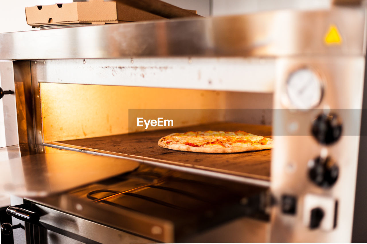 Close-Up Of Pizza In Oven