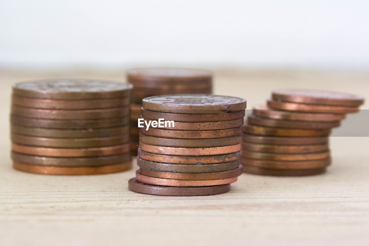 Close-up of stacked coins on table