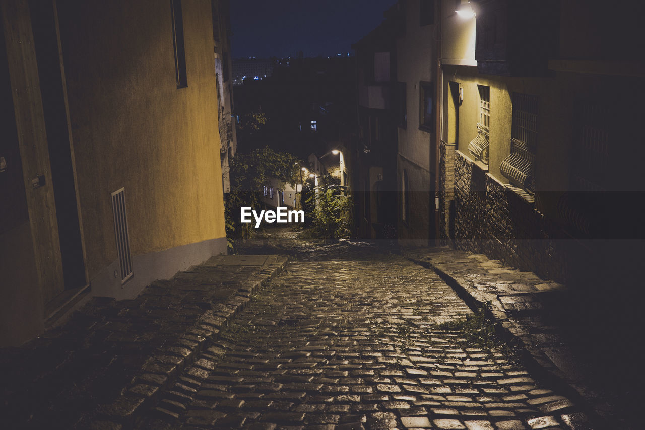 cobblestone, building exterior, night, architecture, built structure, the way forward, no people, outdoors