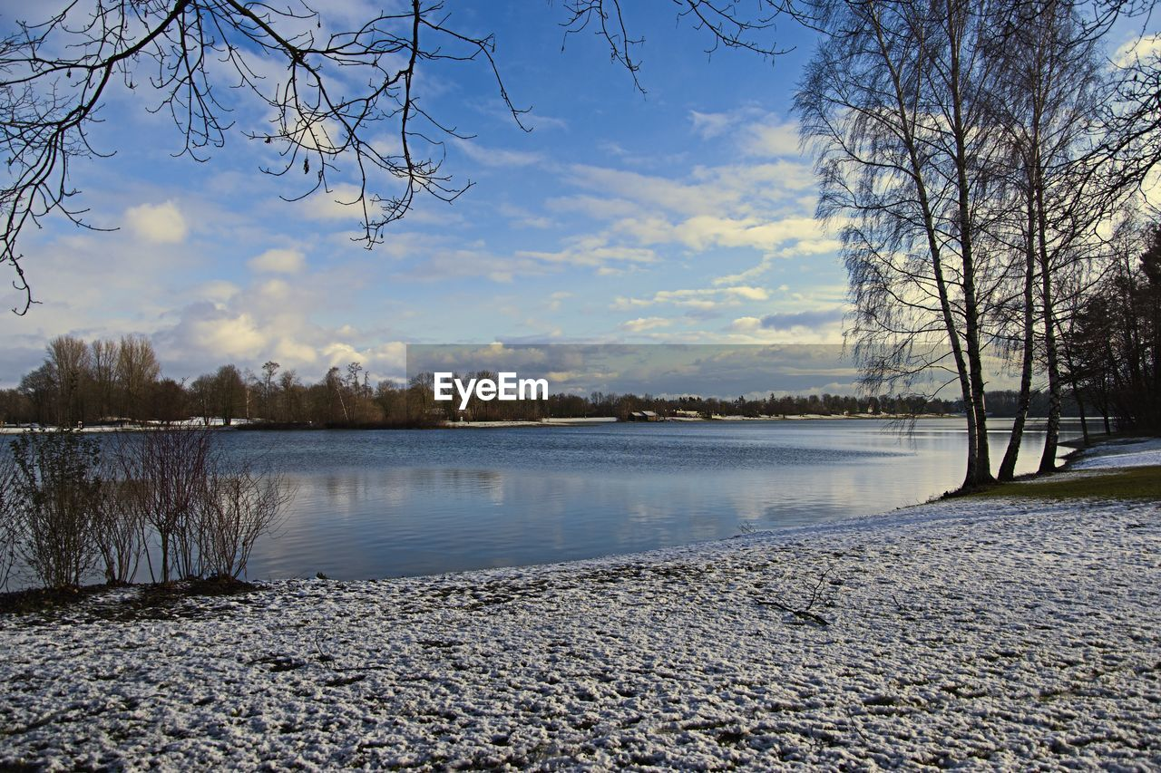 tree, bare tree, water, cold temperature, nature, winter, lake, sky, beauty in nature, tranquil scene, snow, no people, scenics, outdoors, tranquility, frozen, cloud - sky, branch, landscape, day, sunset