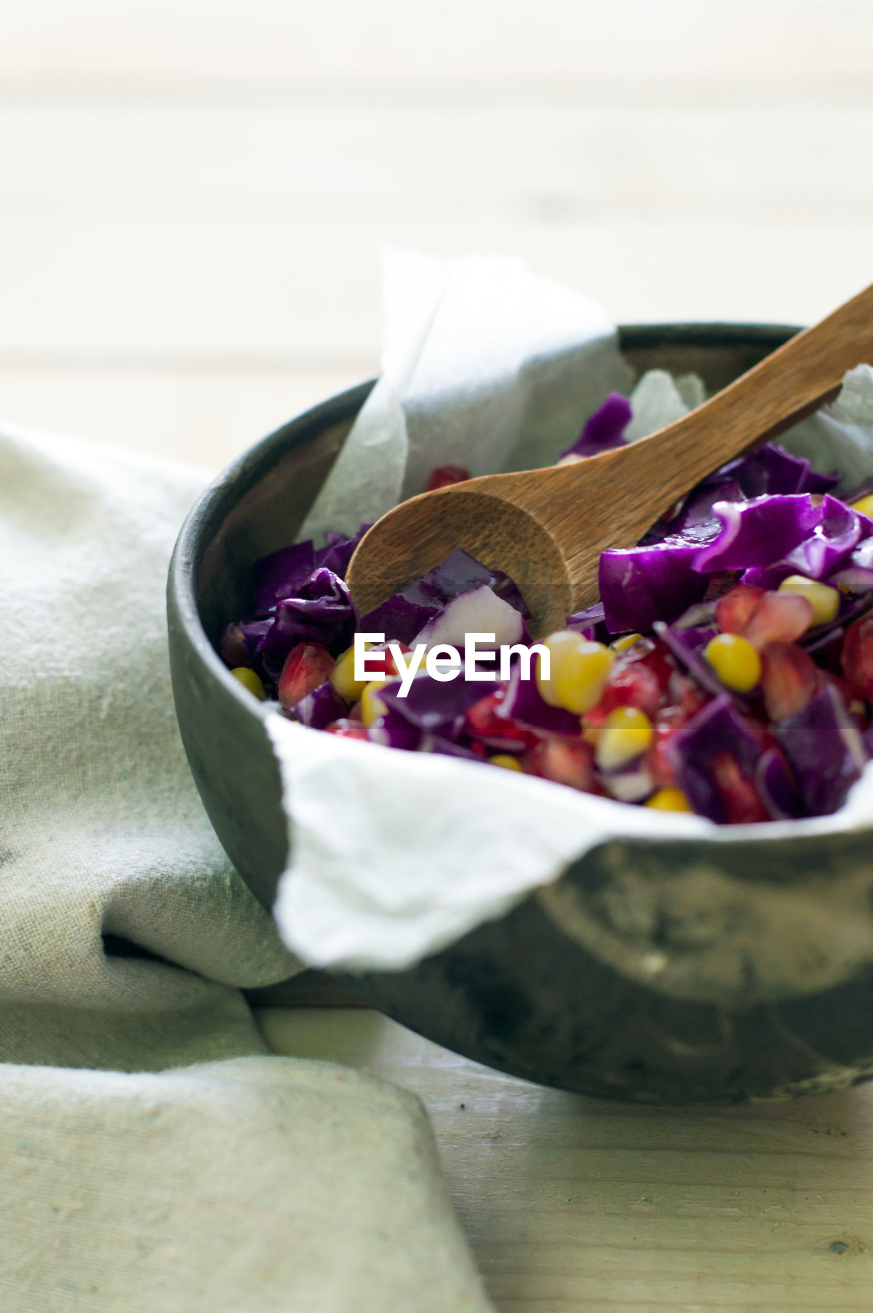 CLOSE-UP OF PURPLE FLOWERS IN BOWL