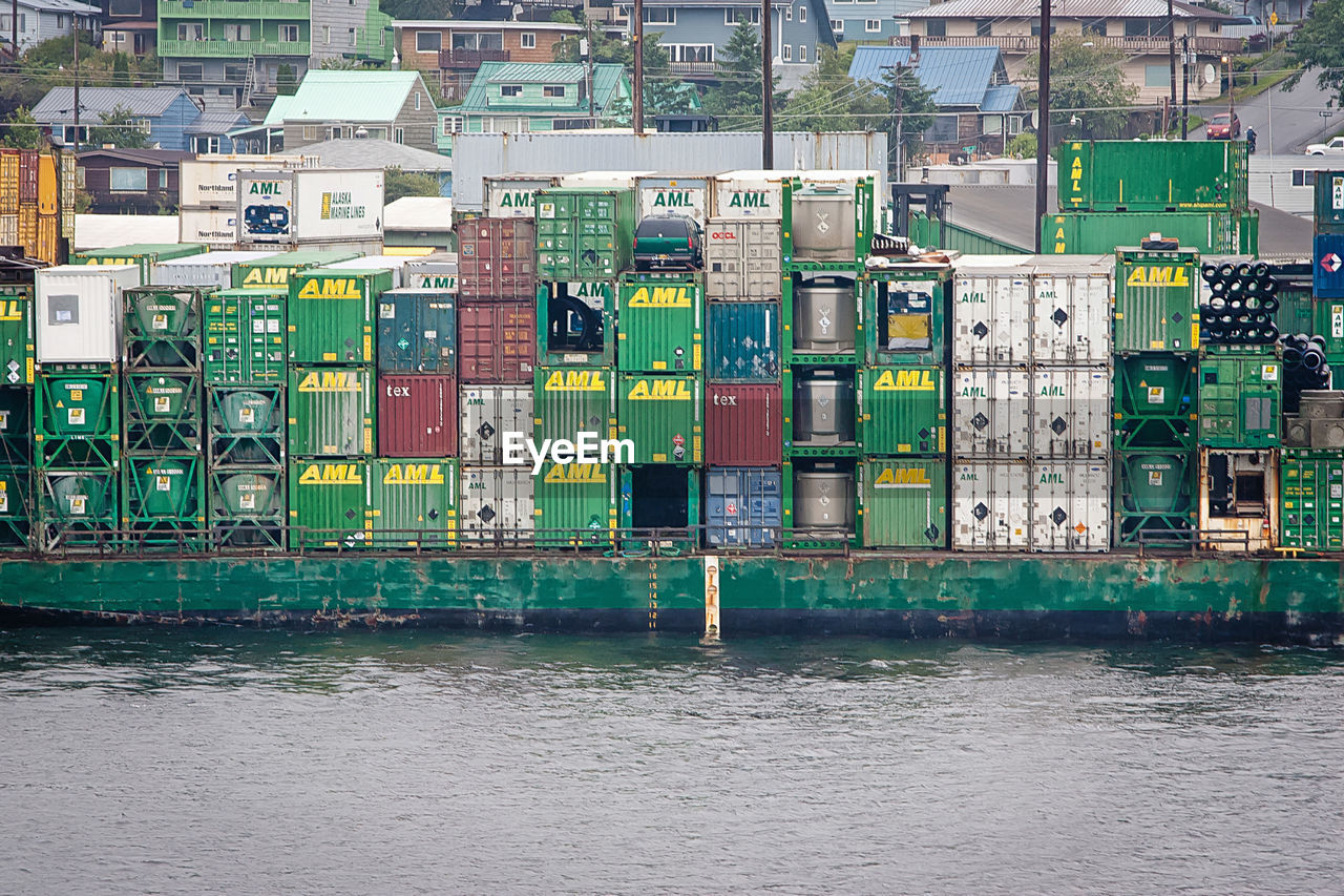 Cargo containers on barge sailing in sea