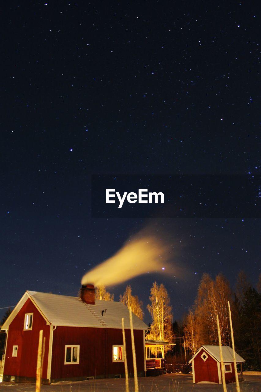 House Emitting Smoke Against Star Field