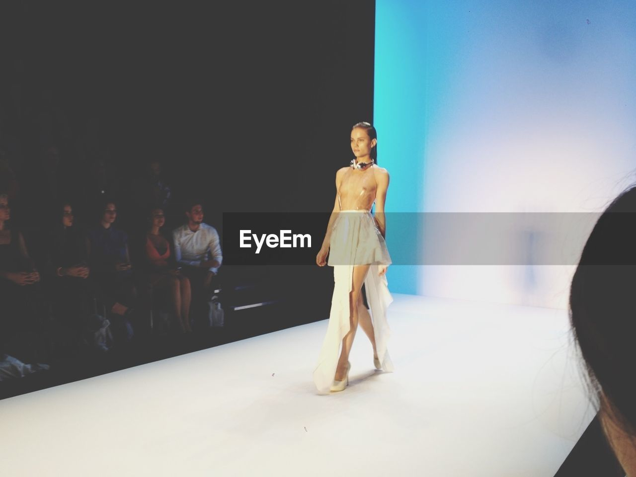 full length, indoors, real people, standing, fashion show, performance, young adult, young women, stage - performance space, performing arts event, one person, fashion model, well-dressed, day, people
