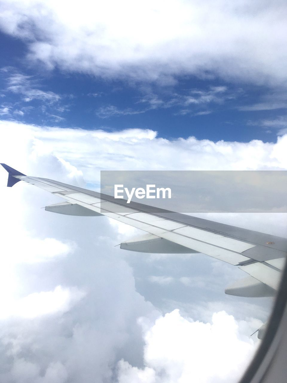 airplane, cloud - sky, sky, transportation, journey, air vehicle, day, mode of transport, airplane wing, no people, travel, outdoors, nature
