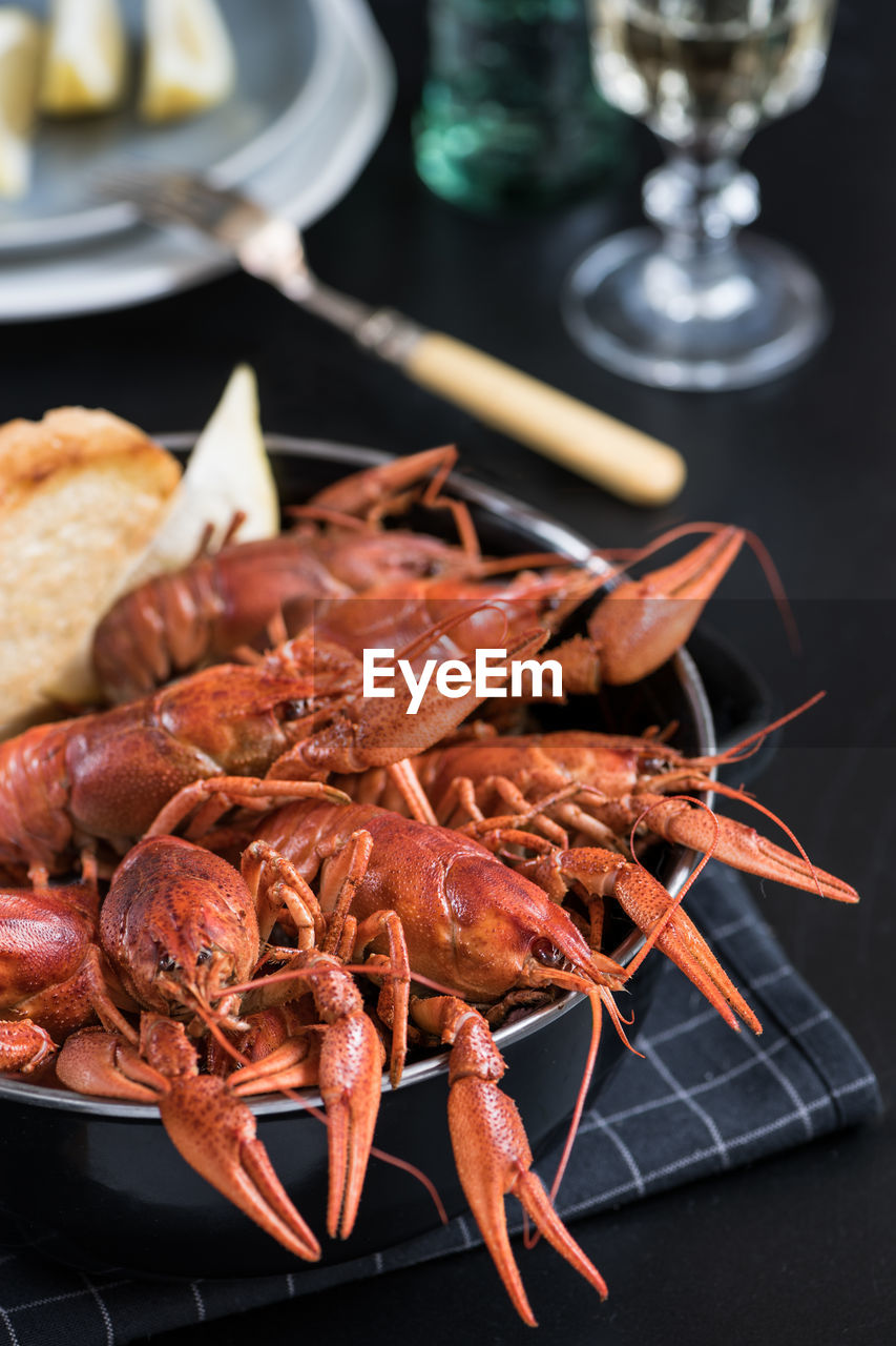 food, food and drink, seafood, freshness, crustacean, still life, no people, indoors, healthy eating, close-up, ready-to-eat, table, wellbeing, plate, high angle view, meat, lobster, focus on foreground, shrimp - seafood, orange color, temptation
