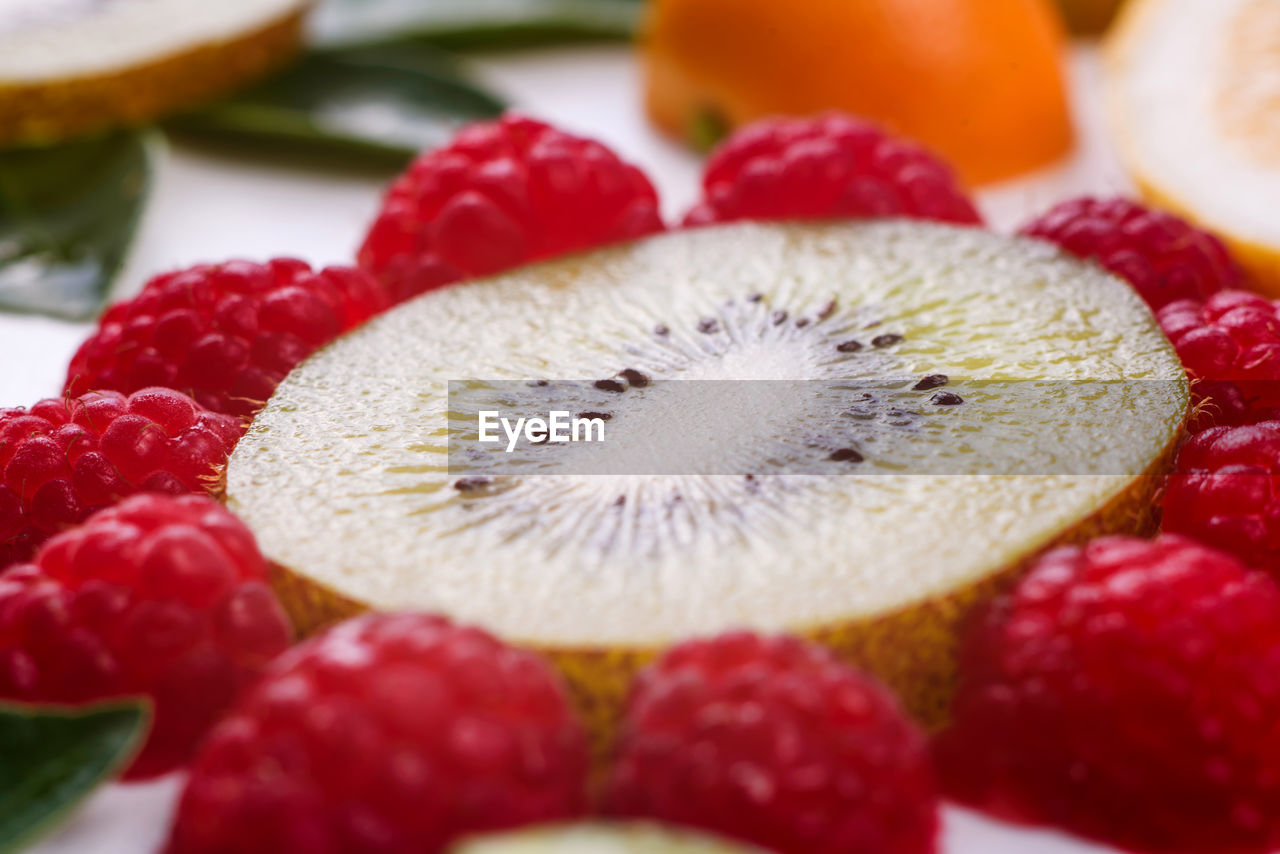 food, food and drink, berry fruit, freshness, healthy eating, fruit, dessert, close-up, sweet, still life, strawberry, red, indulgence, sweet food, selective focus, kiwi, cake, temptation, indoors, no people, tart - dessert