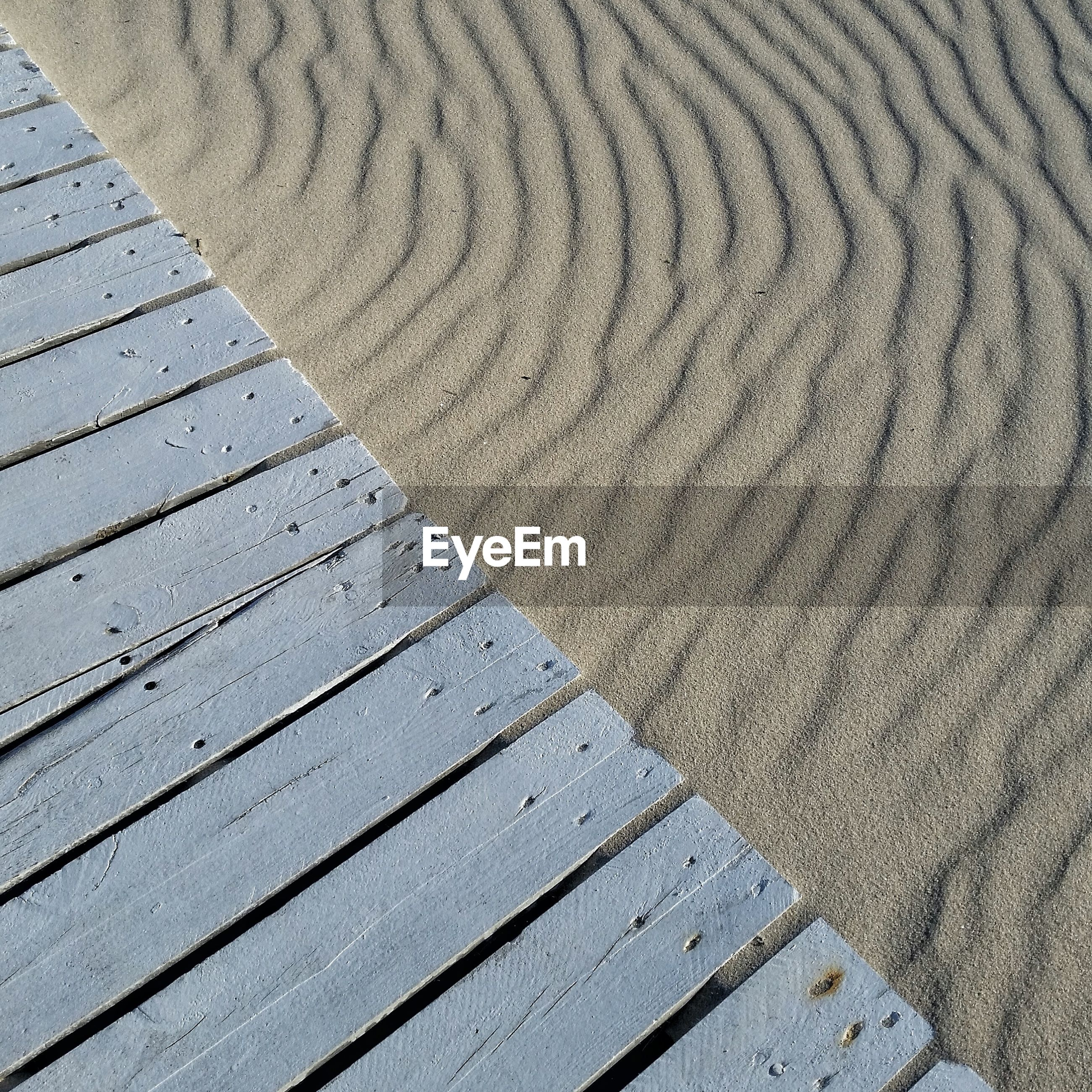 High angle view of jetty over sand