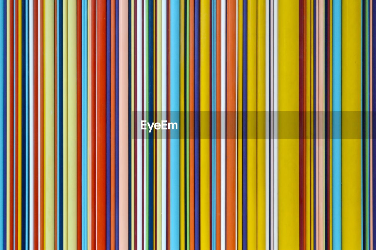 multi colored, backgrounds, full frame, pattern, no people, yellow, close-up, in a row, abstract, variation, large group of objects, choice, indoors, studio shot, repetition, striped, vibrant color, industry, simplicity, pencil