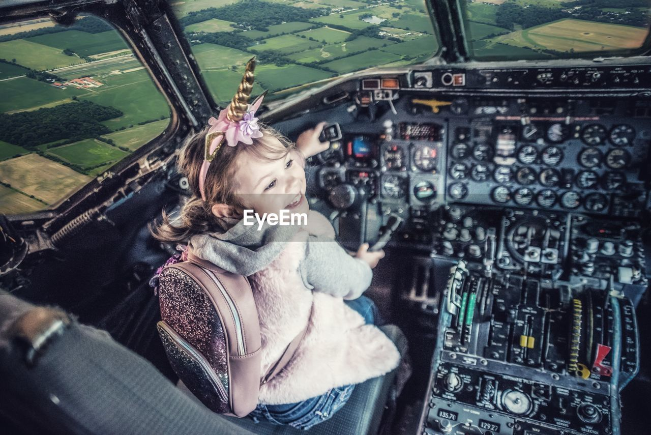 Girl sitting in helicopter