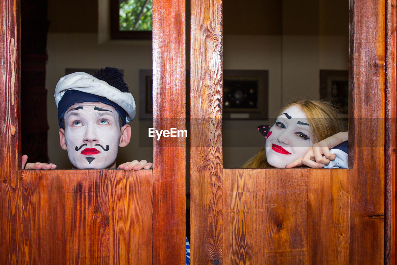 Portrait of man and woman wearing stage make-up