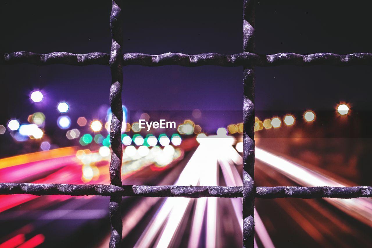 Close-Up Of Illuminated Bridge In City At Night