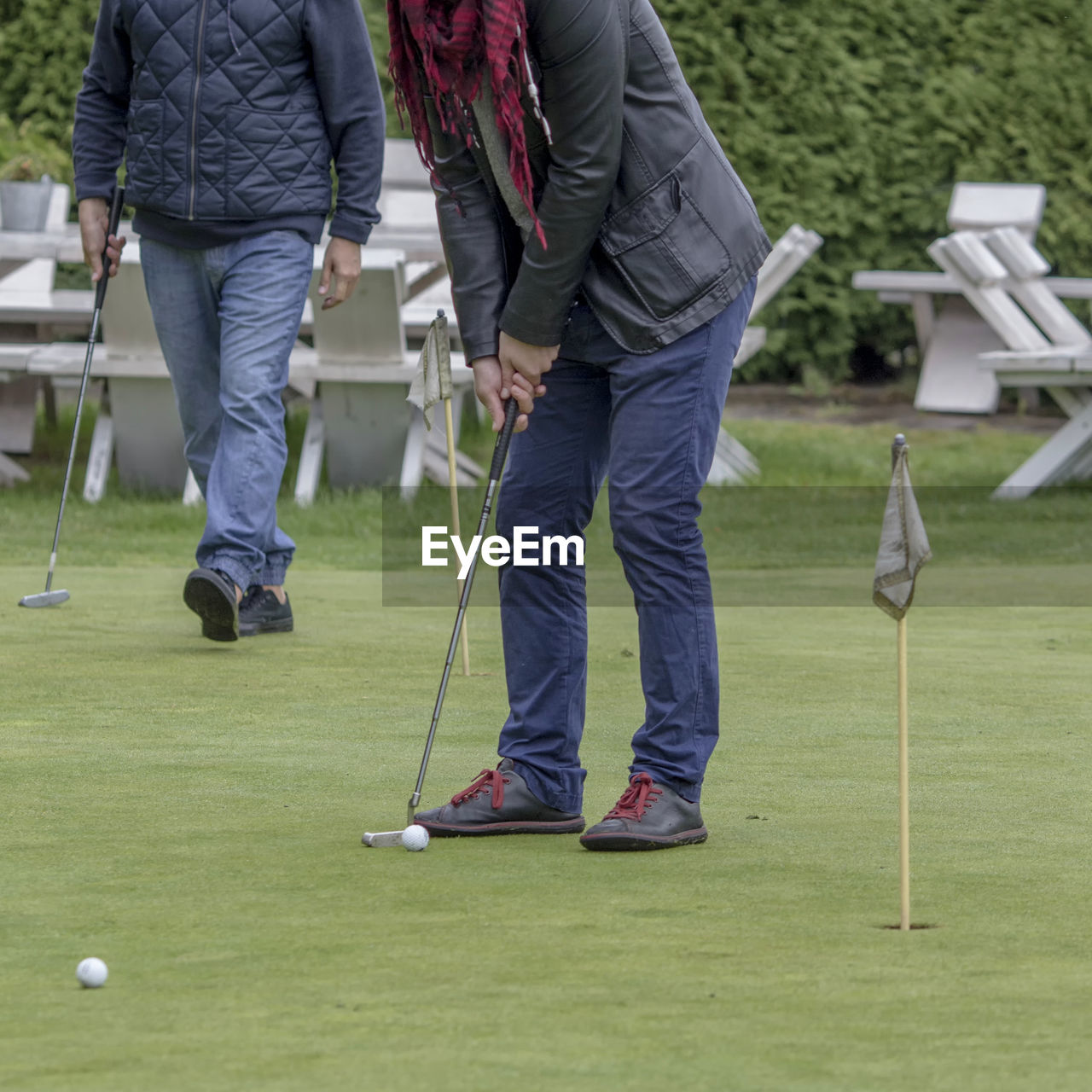 Low Section Of People Playing Golf