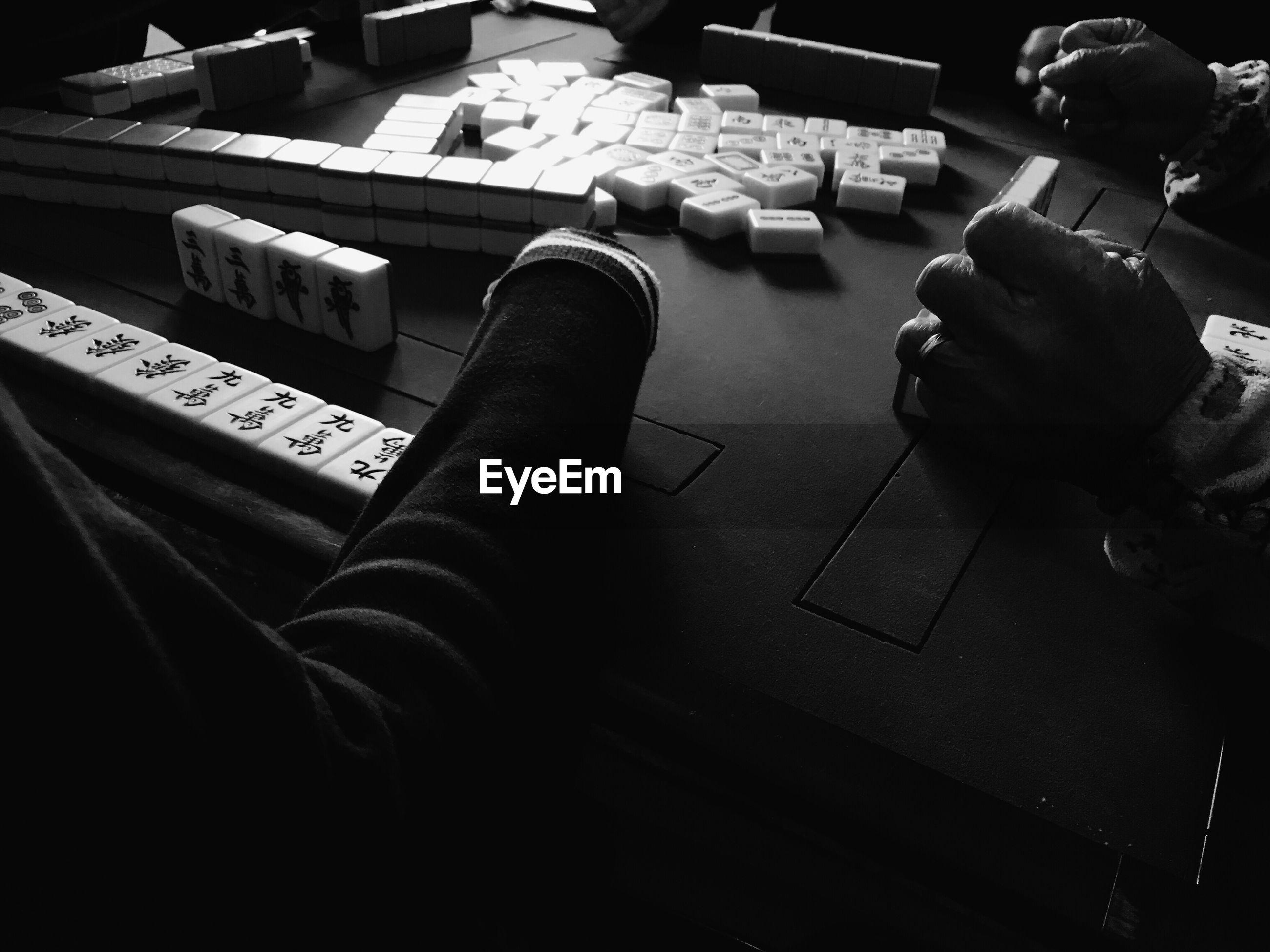 High angle view of people playing mahjong at table