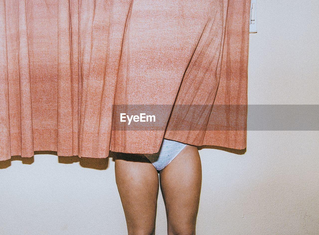 Woman behind curtain