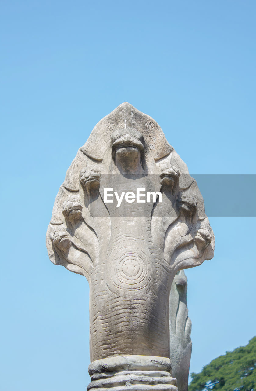 Low Angle View Of Snake Statue Against Clear Blue Sky