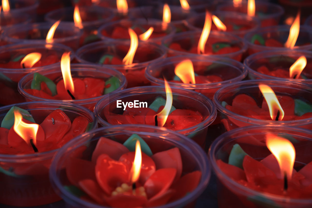 fire, burning, flame, fire - natural phenomenon, candle, heat - temperature, illuminated, glowing, no people, close-up, nature, spirituality, large group of objects, tea light, indoors, religion, full frame, backgrounds, belief, high angle view